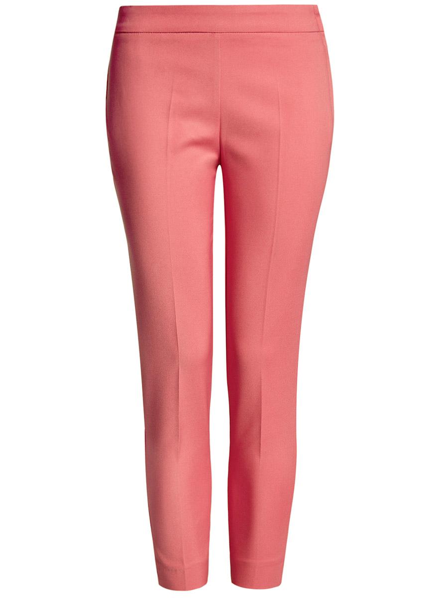 Брюки женские oodji Ultra, цвет: розовый. 11703095/33574/4100N. Размер 44-170 (50-170)11703095/33574/4100NЖенские укороченные брюки oodji Ultra выполнены из высококачественного материала. Зауженная модель стандартной посадки застегивается сбоку на застежку-молнию.