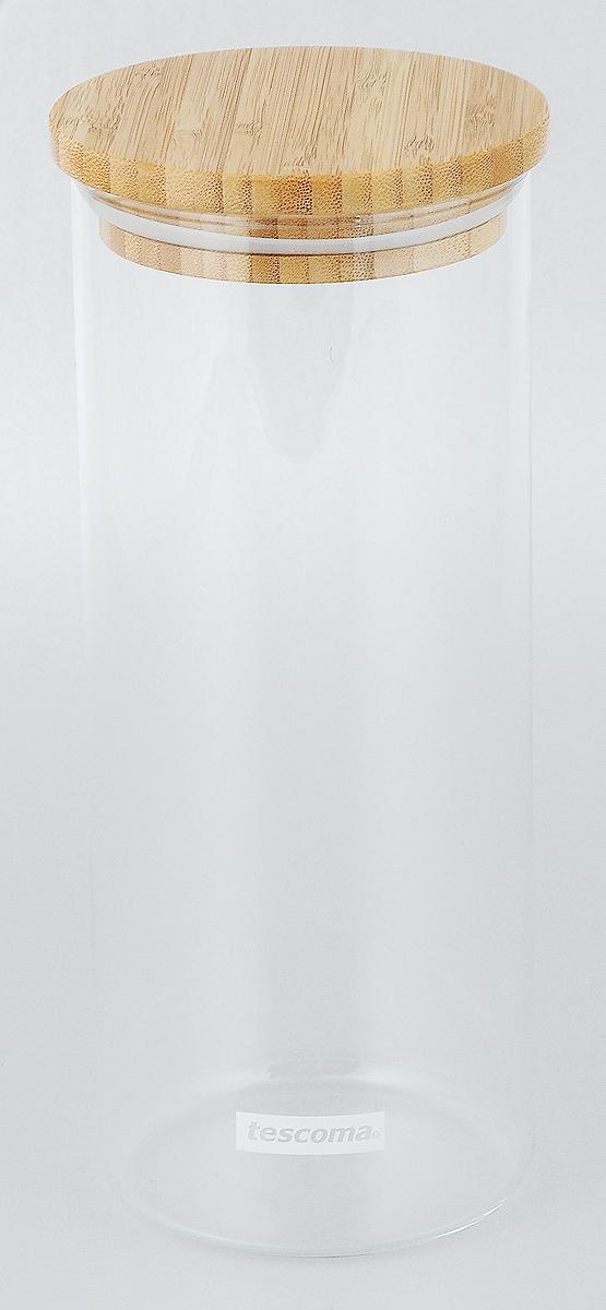 Банка для сыпучих продуктов Tescoma Fiesta, 1,4л894624Банка Tescoma Fiesta изготовлена из высококачественного стекла. Емкость подходит для хранения сыпучих продуктов: круп, специй, сахара, соли. Она снабжена деревянной крышкой, которая плотно и герметично закрывается, дольше сохраняя аромат и свежесть содержимого. Банка Tescoma Fiesta станет полезным приобретением и пригодится на любой кухне.Высота банки (без учета крышки): 23 см.Высота банки (с учетом крышки): 24 см.Диаметр банки (по верхнему краю): 9,5 см.Объем банки: 1,4 л.