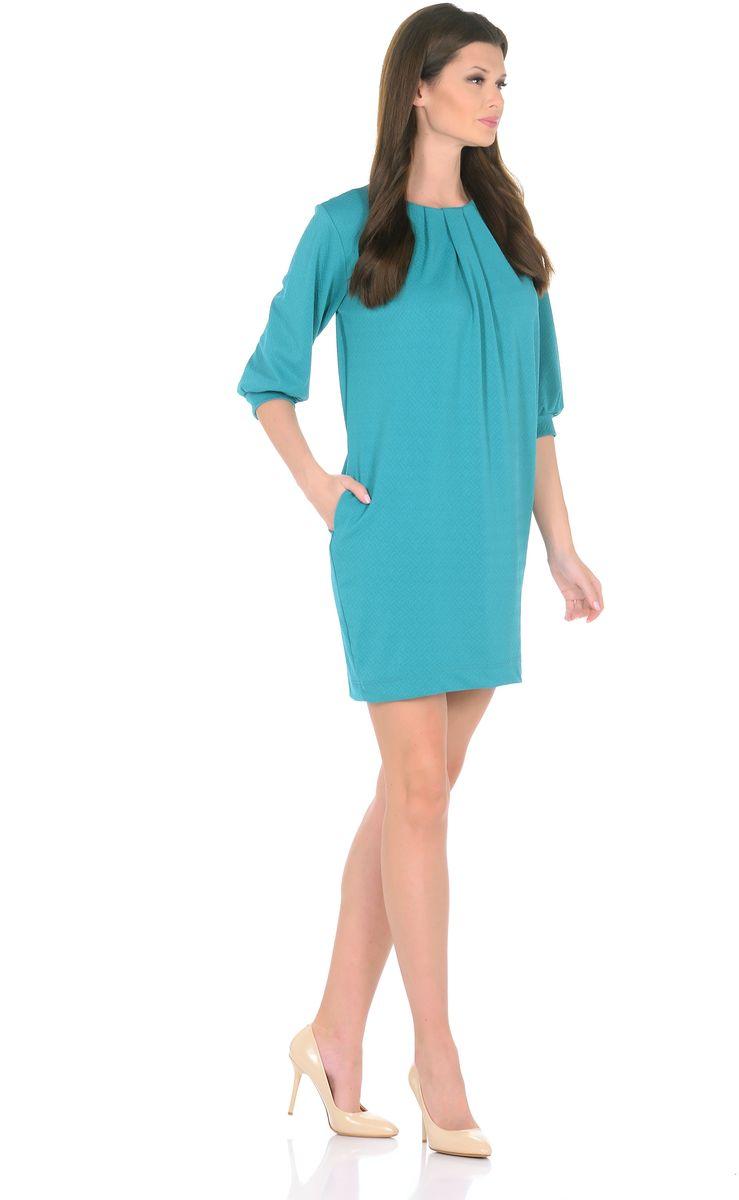 Платье Rosa Blanco, цвет: бирюзовый. 3285-10. Размер 443285-10Модное платье Rosa Blanco станет отличным дополнением к вашему гардеробу. Модель изготовлена из сочетания качественных материалов. Платье-миди прямого кроя и рукавами 3/4 имеет круглый вырез горловины. Модель без застежек. Платье приобретает особый шарм за счет стильных складок у горловины и на рукавах. В боковых швах изделие дополнено двумя втачными карманами.