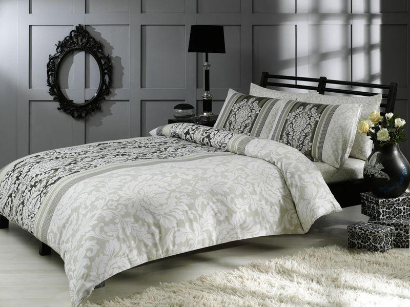 Комплект белья TAC Hazel, семейный, наволочки 50x70, цвет: серый3082-15617Роскошный комплект постельного белья TAC Hazel выполнен из качественного плотного сатина (100% хлопок). Комплект состоит из двух пододеяльников, простыни и двух наволочек. Пододеяльник застегивается на пуговицы.Сатин - гладкая и прочная ткань, которая своим блеском, легкостью и гладкостью похожа на шелк, но выгодно отличается от него в цене. Сатин практически не мнется, поэтому его можно не гладить. Ко всему прочему, он весьма практичен, так как хорошо переносит множественные стирки.Доверьте заботу о качестве вашего сна высококачественному натуральному материалу.