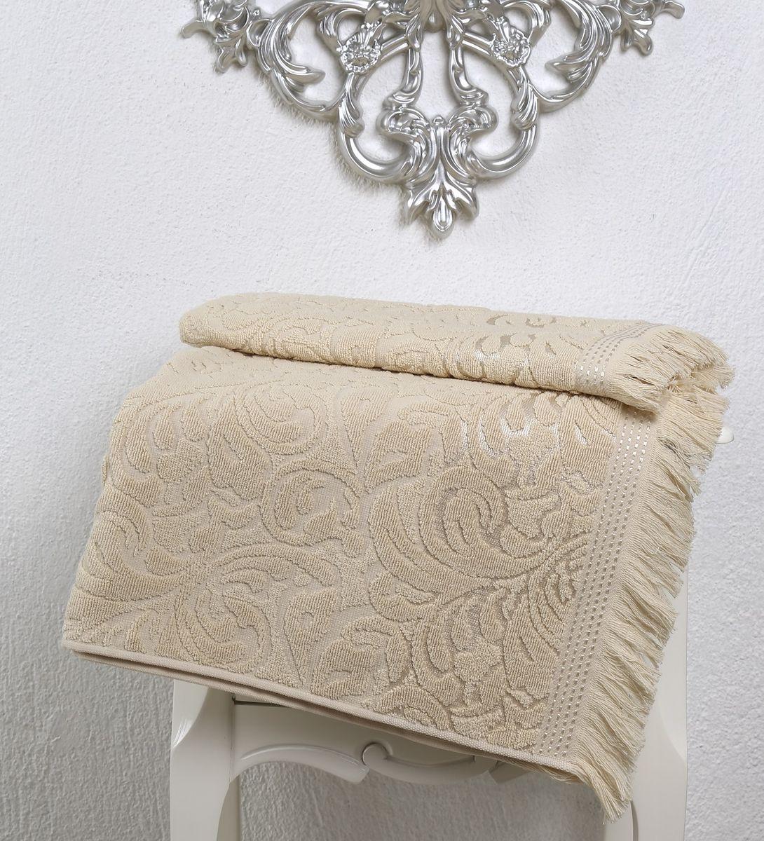 Полотенце Karna Esra, цвет: бежевый, 70 х 140 см2195/CHAR003Полотенце махровое Karna изготавливают из высококачественных хлопковых нитей. Хлопковые нити прядутся из длинных волокон. Длина волокон хлопковой нити влияет на свойства ткани, чем длиннее волокна, тем махровое изделие прочнее, пушистее и мягче на ощупь. А также махровое изделие будет отлично впитывать воду и быстро сохнуть. На впитывающие качества махры (ее гигроскопичность), конечно же, влияет состав волокон. Махра абсолютно не аллергенна, имеет высокую воздухопроницаемость и долгий срок использования ткани.Отличительной особенностью данной модели являются ее оригинальный рисунок (вышивка) и подарочная упаковка. Декор в виде вышивки и бахромы хорошо смотрится. Вышитые изображения отличаются своей долговечностью и практичностью, они не выгорают и не линяют.