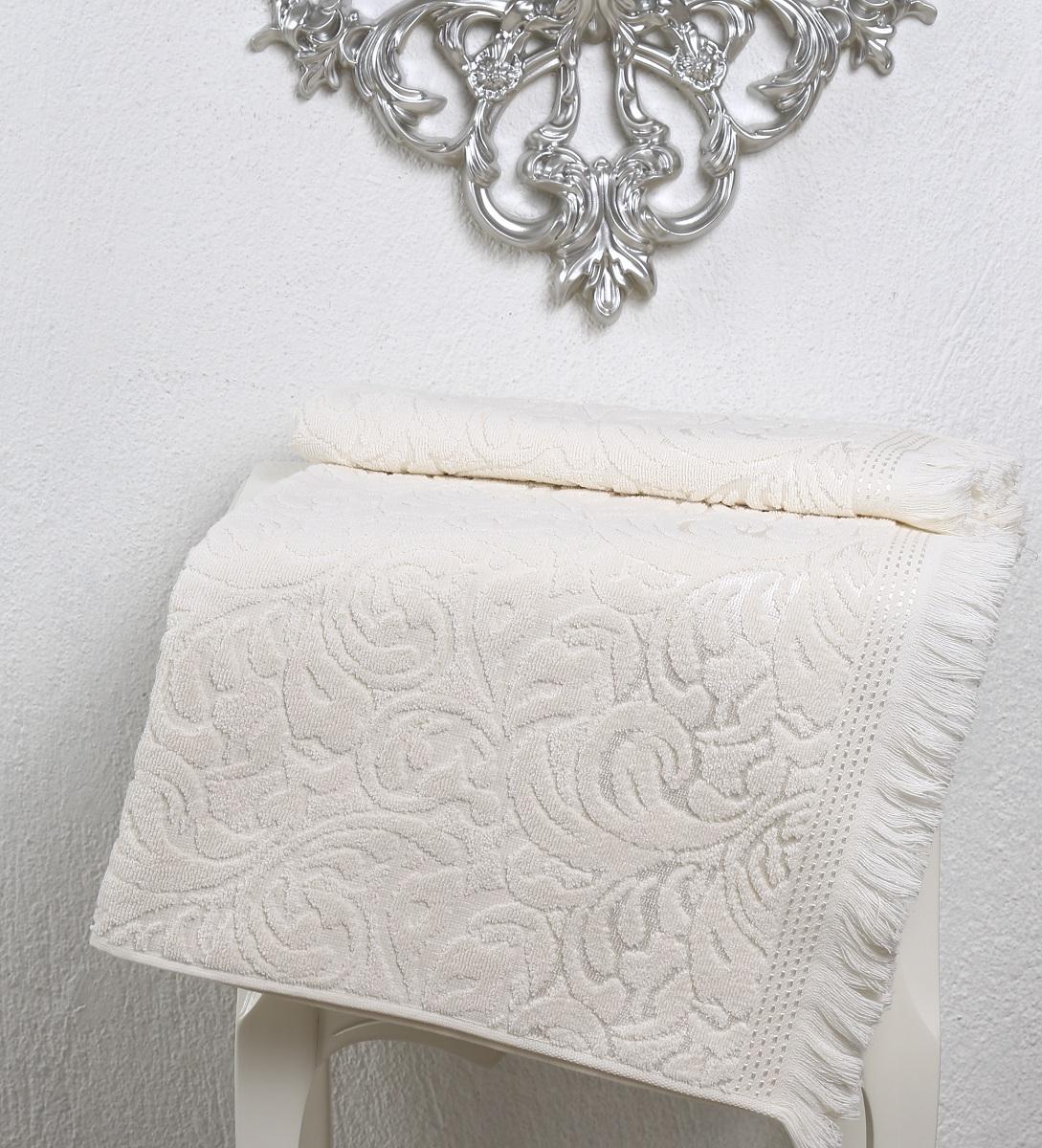 Полотенце Karna Esra, цвет: кремовый, 70 х 140 см2195/CHAR005Махровое полотенце Karna Esra выполнено из 100% хлопка. Оно прекрасно впитывает влагу и быстро сохнет. Повсему полотенцу имеется привлекательный узор. По канту полотенца имеется нежная бахрома. Махровое полотенце из натурального хлопка, обладает гигиеническими качествами, очень мягкое, с объемнымравномерным ворсом, приятное на ощупь и к телу. Размер: 70 х 140 см.
