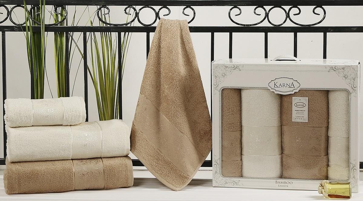 Набор кухонных полотенец Karna Pandora, цвет: кремовый, кофейный, 4 шт2198/CHAR010Кухонные полотенца Karna Pandora изготовлены из экологически чистого материала - бамбуковой махры. Бамбуковая махра делается из бамбуковых волокон. Бамбуковые волокна имеют дышащую структуру и обладают отличными свойствами впитывать влагу приблизительно на 60% больше, чем хлопок.Полотенца не образуют статического электричества и легко стираются.Отличительной особенностью данной модели является её оригинальный жаккардовый рисунок.В наборе 4 полотенца.Размер: 50 x 90 см, 90 x 150 см.