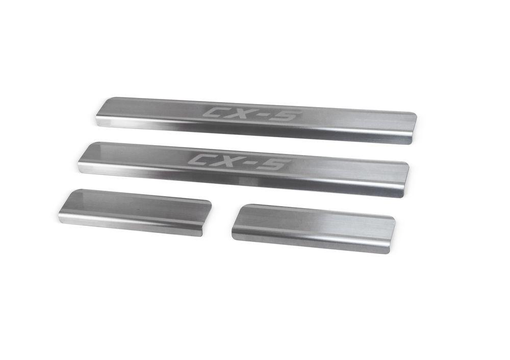 Накладки на пороги Rival, для Mazda CX-5 2011-, 4 штNP.3803.3Накладка на пороги Rival защищают лакокрасочное покрытие от механических повреждений и создают индивидуальный внешний вид автомобиля.- Накладки изготовлены из высококачественной итальянской нержавеющей стали AISI 304.- Надежная фиксация на автомобиле с помощью фирменного скотча 3М.- Устойчивое к истиранию изображение на накладках нанесено методом абразивной полировки- Идеально повторяют геометрию порогов автомобиля.Уважаемые клиенты!Обращаем ваше внимание, что накладка имеет форму и комплектацию, соответствующую модели данного автомобиля. Фото служит для визуального восприятия товара.