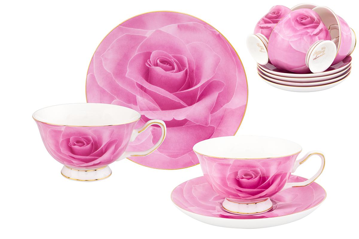 """Чайный набор Elan Gallery """"Роза"""" состоит из 6 чашек, 6 блюдец, изготовленных из высококачественного фарфора. Предметы набора декорированы изображением цветов.  Чайный набор Elan Gallery """"Роза"""" украсит ваш кухонный стол, а также станет замечательным подарком друзьям и близким.Изделие упаковано в подарочную коробку с атласной подложкой. Не рекомендуется применять абразивные моющие средства. Не использовать в микроволновой печи.  Объем чашки: 200 мл.Размер чашек: 12,5 х 10 х 6 см. Размер блюдец: 15 х 15 х 2 см."""