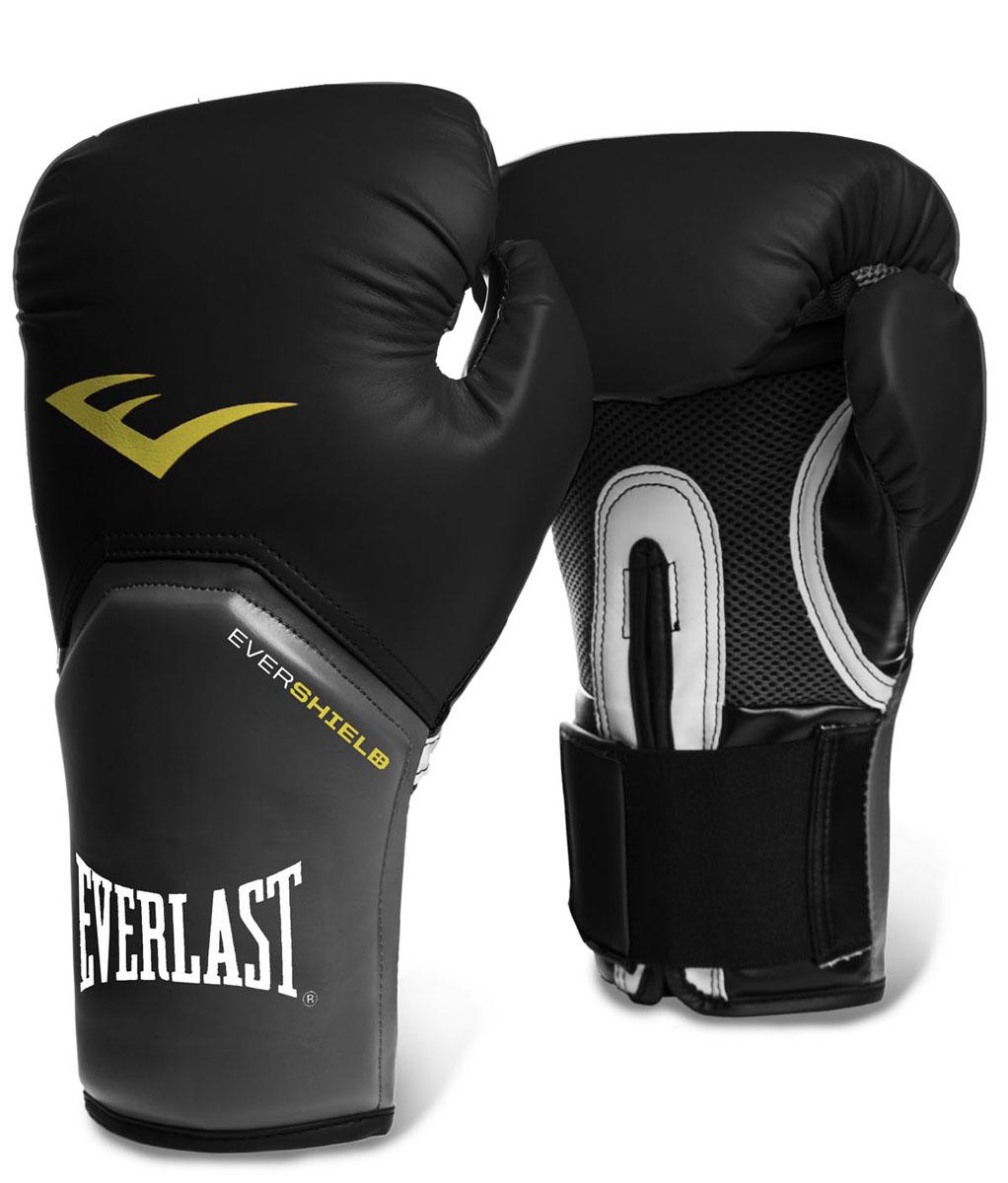 Боксерские перчатки Everlast ProStyle Elite, цвет: черный. Вес 10 унций2310EEverlast ProStyle Elite — тренировочные боксерские перчатки для спаррингов и работы на снарядах. Изготовлены из качественной искусственной кожи с применением технологий Everlast, использующихся в экипировке профессиональных спортсменов. Благодаря выверенной анатомической форме перчатки надежно фиксируют руку и гарантируют защиту от травм. Нижняя часть, полностью изготовленная из сетчатого материала, обеспечивает циркуляцию воздуха и препятствует образованию влаги, а также неприятного запаха за счет антибактериальной пропитки EVERFRESH. Комбинация легких дышащих материалов поддерживает оптимальную температуру тела. Модель подходит для начинающих боксеров, которые хотят тренироваться с экипировкой высокого класса.