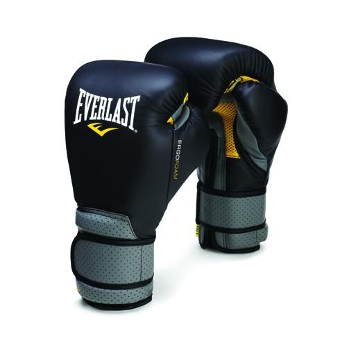 Перчатки тренировочные Everlast Ergo Foam, цвет: черный, серый. Вес 12 унцийP00000138Боксерские перчатки Ergofoam Gloves - легкие и прочные закрытые полноразмерные перчатки с усиленной вентиляцией. Вставки из литой пены обеспечивают повышенную защиту в тех местах, где в обычных перчатках рука чаще всего не защищена. За счет грамотного распределения зон нагрузки внутри перчатки рука чувствует удобнее, ее положение более естественное. Перчатки изготовлены из высокотехнологичной искусственной кожи с лазерной перфорацией. Фиксирующие элементы тоже снабжены вентиляцией, а значит, запястьям будет не так жарко как в обычных перчатках. Технологии: - С3 FOAM - вставки из литой пены - сила и защищенность каждого вашего удара. - EVERCOOL - вентиляционная система и дышащие материалы, объединенные в технологию Evercool обеспечат точный контроль за регуляцией температуры тела.