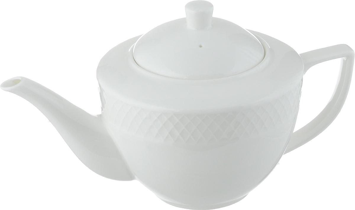Чайник заварочный Wilmax Julia Vysotskaya, 900 млWL-880110-JV / 1CЗаварочный чайник Wilmax Julia Vysotskaya изготовлен из высококачественного фарфора. Глазурованное покрытие обеспечивает легкую очистку. Изделие прекрасно подходит для заваривания вкусного и ароматного чая, а также травяных настоев. Отверстия в основании носика препятствует попаданию чаинок в чашку. Оригинальный дизайн сделает чайник настоящим украшением стола. Он удобен в использовании и понравится каждому.Можно мыть в посудомоечной машине и использовать в микроволновой печи. Диаметр чайника (по верхнему краю): 9 см. Высота чайника (без учета крышки): 10,5 см. Высота чайника (с учетом крышки): 14 см.