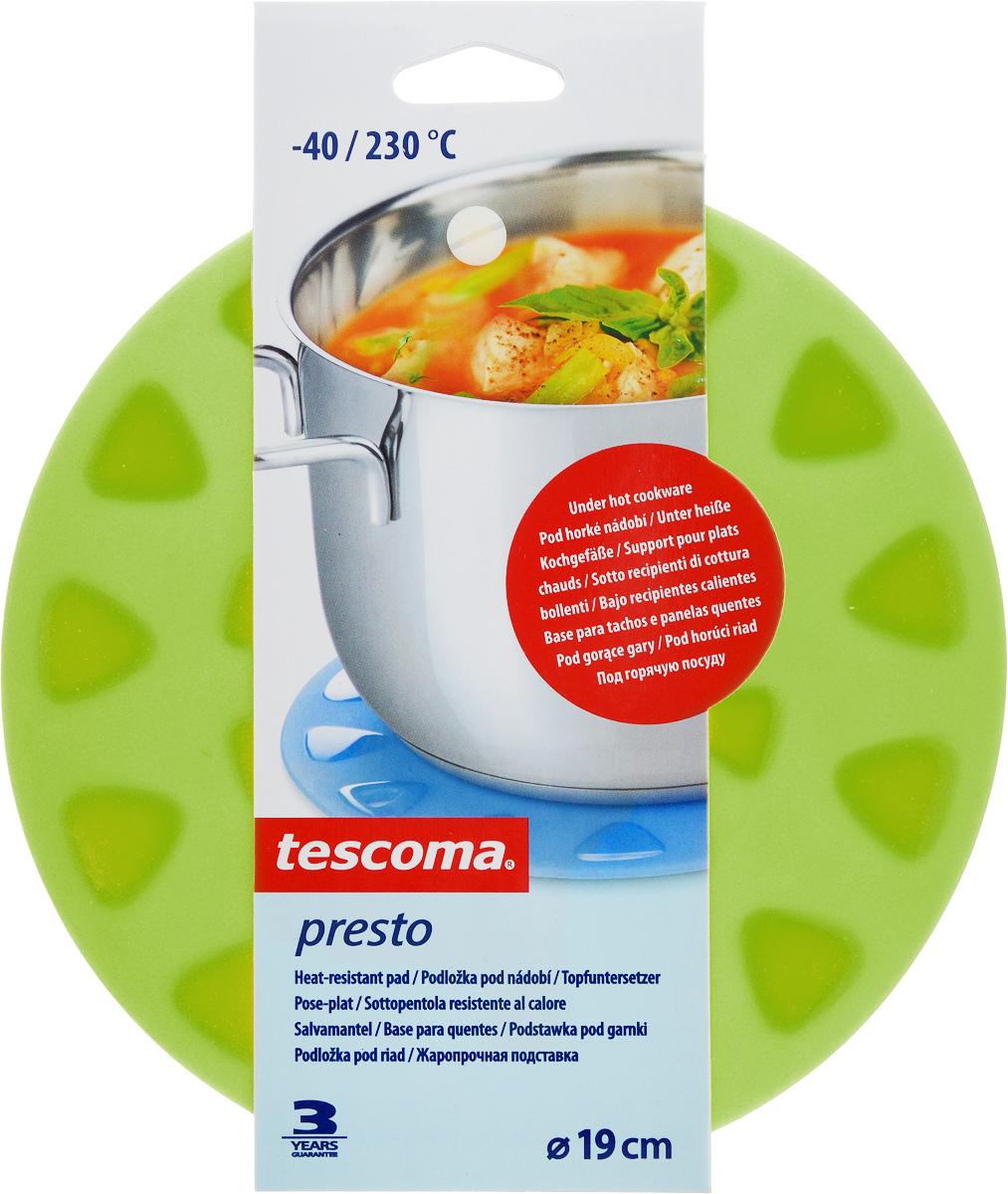 Подставка для горячего Tescoma Presto, цвет: зеленый, диаметр 19см420938_зеленыйЖаропрочная подставка Tescoma Presto прекрасно подходит в качестве подставки под горячую посуду. Подставка изготовлена из силикона. Для удобства размещения и экономии пространства в подставке есть отверстие, с помощью которого ее можно повесить в любом удобном для вас месте. Подставка выдерживает температуру от -40°С до +230°С.Можно использовать в холодильнике, морозильной камере, мыть в посудомоечной машине.Размеры: 19 х 19 х 3 см.