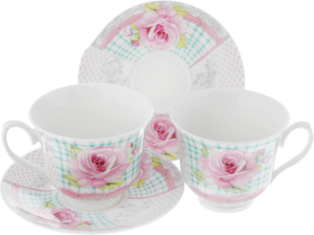 Набор чайный Loraine, цвет: розовый, белый, зеленый, 4 предмета22958Чайный набор Loraine, выполненный из керамики, состоит из 2 чашек и 2 блюдец. Предметы набора имеют яркую расцветку. Изящный дизайн и красочность оформления придутся по вкусу и ценителям классики, и тем, кто предпочитает современный стиль. Чайный набор - идеальный и необходимый подарок для вашего дома и для ваших друзей в праздники, юбилеи и торжества! Он также станет отличным корпоративным подарком и украшением любой кухни. Чайный набор упакован в подарочную коробку из плотного цветного картона. Внутренняя часть коробки задрапирована белым атласом.Диаметр кружки (по верхнему краю): 9,3 см.Высота стенки: 7,5 см.Размеры блюдца: 13,6 х 14,2 см.Высота блюдца: 1,5 см.Объем чашки: 240 см.