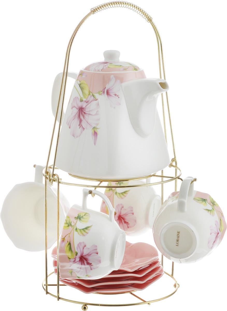 Набор чайный Loraine, на подставке, 10 предметов. 2473724737Чайный набор Loraine состоит из 4 чашек, 4 блюдец, заварочного чайника и подставки. Посуда изготовлена из качественной глазурованной керамики и оформлена изображением цветов. Блюдца и чашки имеют необычную фигурную форму. Все предметы располагаются на удобной металлической подставке с ручкой. Элегантный дизайн набора придется по вкусу и ценителям классики, и тем, кто предпочитает современный стиль. Он настроит на позитивный лад и подарит хорошее настроение с самого утра. Чайный набор Loraine идеально подойдет для сервировки стола и станет отличным подарком к любому празднику. Можно использовать в СВЧ и мыть в посудомоечной машине. Объем чашки: 250 мл. Размеры чашки (по верхнему краю): 8,7 х 9 см. Высота чашки: 6,2 см. Диаметр блюдца: 14 см. Высота блюдца: 1,5 см.Объем чайника: 1,1 л. Размер чайника (без учета ручки и носика): 13 х 13 х 13 см. Размер подставки: 18 х 18 х 37 см.
