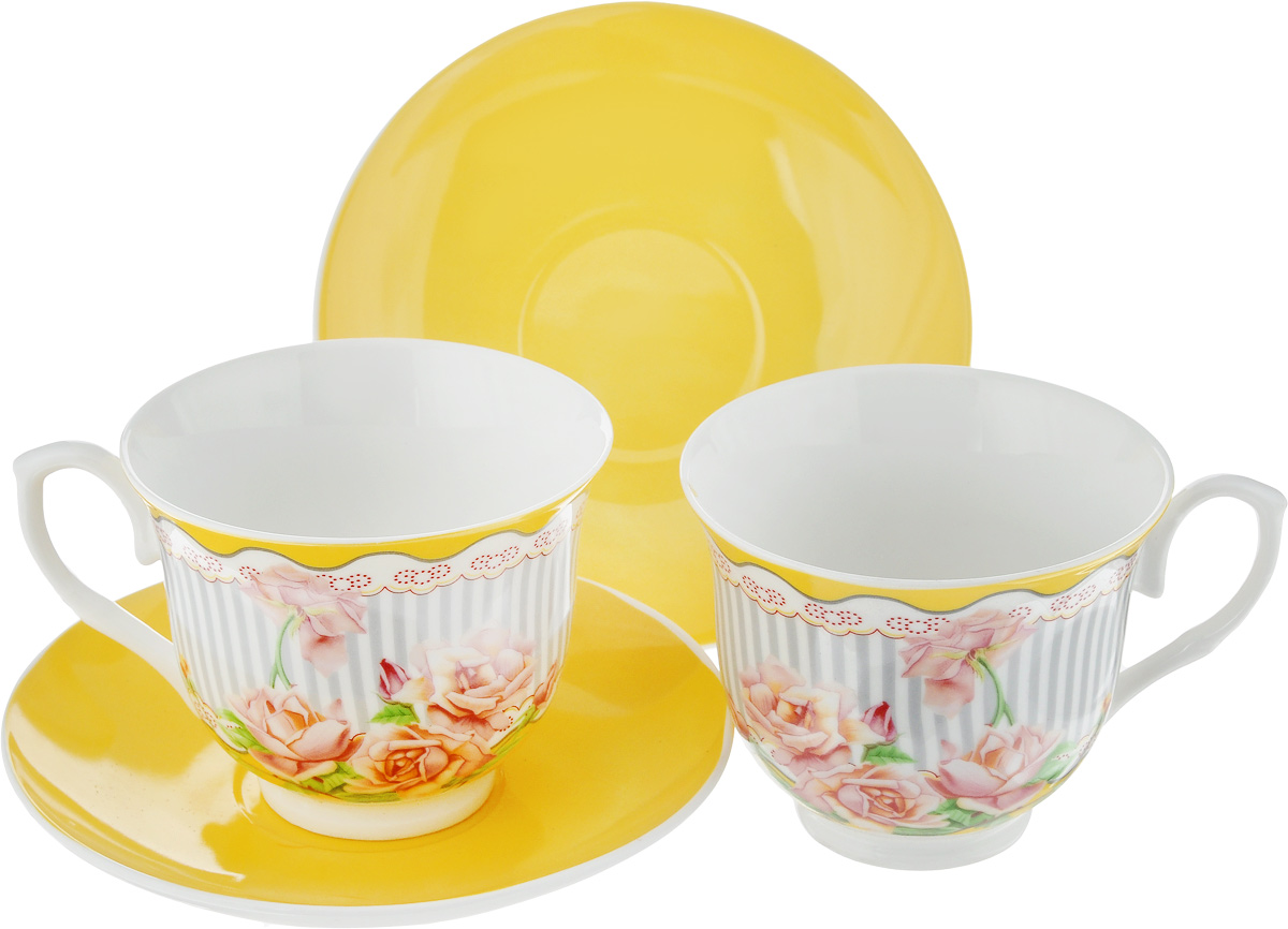 Набор чайный Loraine Садовые розы, цвет: желтый, серый, зеленый, 4 предмета. 2298922989Чайный набор Loraine Садовые розы, выполненный из керамики, состоит из 2 чашек и 2 блюдец. Предметы набора имеют яркую расцветку. Изящный дизайн и красочность оформления придутся по вкусу и ценителям классики, и тем, кто предпочитает современный стиль. Чайный набор - идеальный и необходимый подарок для вашего дома и для ваших друзей в праздники, юбилеи и торжества! Он также станет отличным корпоративным подарком и украшением любой кухни. Чайный набор упакован в подарочную коробку из плотного цветного картона. Внутренняя часть коробки задрапирована белым атласом.Диаметр кружки (по верхнему краю): 9,3 см.Высота стенки: 7,4 см.Диаметр блюдца: 14,2 см.Высота блюдца: 2 см.Объем чашки: 220 см.