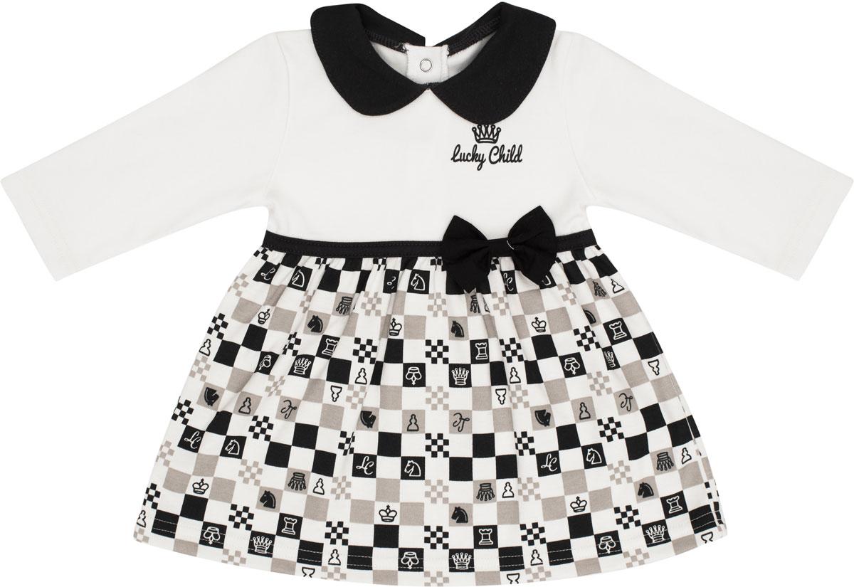 Платье для девочки Lucky Child Шахматный турнир, цвет: молочный, темно-серый, бежевый. 29-6Д. Размер 62/6829-6ДМаленькая принцесса в платье – само очарование. Поэтому с рождением девочки каждая мама начинает грезить о нарядах для своей юной красотки. Зачем ждать, когда можно нарядить маленькую кроху в платье с первых дней жизни? Удобство, красота, изящество и качество – все это соединилось в этом платье. Интерлок, из которого выполнено платье, нежно заботится о самой юной коже. Цветовое сочетание и яркий шахматный принт сделают вашу принцессу самой элегантной и стильной малышкой.