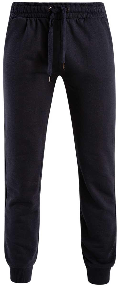 Брюки спортивные мужские oodji Basic, цвет: темно-синий. 5B200003M/44119N/7900N. Размер S (46/48)5B200003M/44119N/7900NМужские спортивные брюки oodji Basic, выполненные из высококачественного материала, великолепно подойдут для отдыха, повседневной носки, а также для занятий спортом. Брюки зауженного к низу кроя и средней посадки имеют широкую эластичную резинку на поясе, объем талии регулируется при помощи шнурка-кулиски. Спереди изделие имеет два втачных кармана, а сзади накладной карман. Низ брючин дополнен широкими манжетами.
