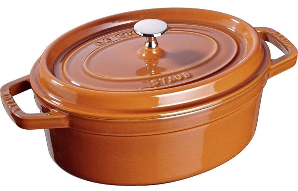 Кокот Staub, овальный, цвет: коричневый, 4,2 л11029806Изготовлен из чугуна, покрытого эмалью снаружи и внутри. Подходит для использования на всех типах плит и в духовке. Перед первым использованием снять этикетки, тщательно вымыть горячей водой с мыльным средством и высушить, затем нанести немного растительного масла на внутреннюю поверхность посуды, излишки масла удалить салфеткой. Мыть жидким моющим средством, без применения абразивных веществ и металлических губок. Пригоден для мытья в посудомоечной машине. При падении на твердую поверхность посуда может треснуть или разбиться. Металлические кухонные принадлежности могут повредить посуду. Избегать резкого нагревания и охлаждения, резкий перепад температуры может привести к повреждению посуды. Чтобы не обжечься, пользуйтесь прихватками. Уважаемые клиенты! Для сохранения свойств посуды из чугуна и предотвращения появления ржавчины чугунную посуду мойте только вручную, горячей или теплой водой, мягкой губкой или щёткой (не металлической) и обязательно вытирайте насухо. Для хранения смазывайте внутреннюю поверхность посуды растительным маслом, а перед следующим применением хорошо накалите посуду.