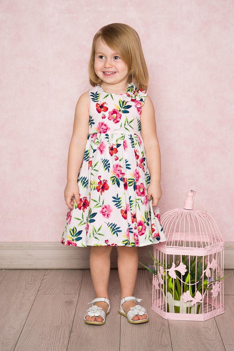 Платье для девочки Sweet Berry Baby, цвет: розовый, фиолетовый. 712023. Размер 92712023Яркое платье для девочки Sweet Berry выполнено из натурального хлопка и оформлено цветочным принтом. Модель средней длины с пышной юбкой-солнцем на хлопковой подкладке застегивается сзади на потайную застежку-молнию. На плече платье декорировано объемными бантиками.