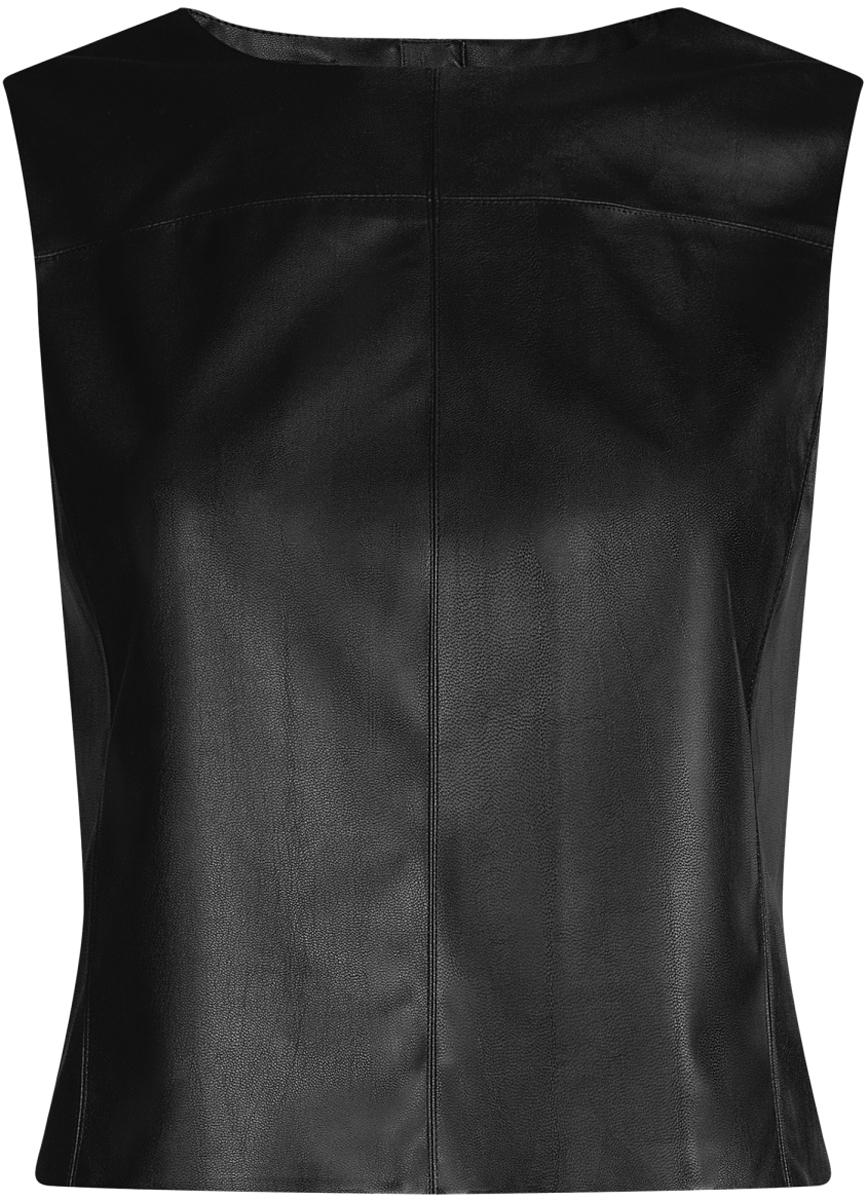 Жилет женский oodji Ultra, цвет: черный. 18C00001/45085/2900N. Размер 38-170 (44-170)18C00001/45085/2900NЛаконичный женский жилет oodji Ultra выполнен из качественной искусственной кожи. Модель приталенного кроя с круглым вырезом горловины застегивается на металлическую молнию на спинке. Жилет можно сочетать с рубашками и блузами или использовать как самостоятельную часть одежды. Такой жилет подойдет для офиса, прогулок и дружеских встреч и будет отлично сочетаться с джинсами и брюками, а также гармонично смотреться с юбками.