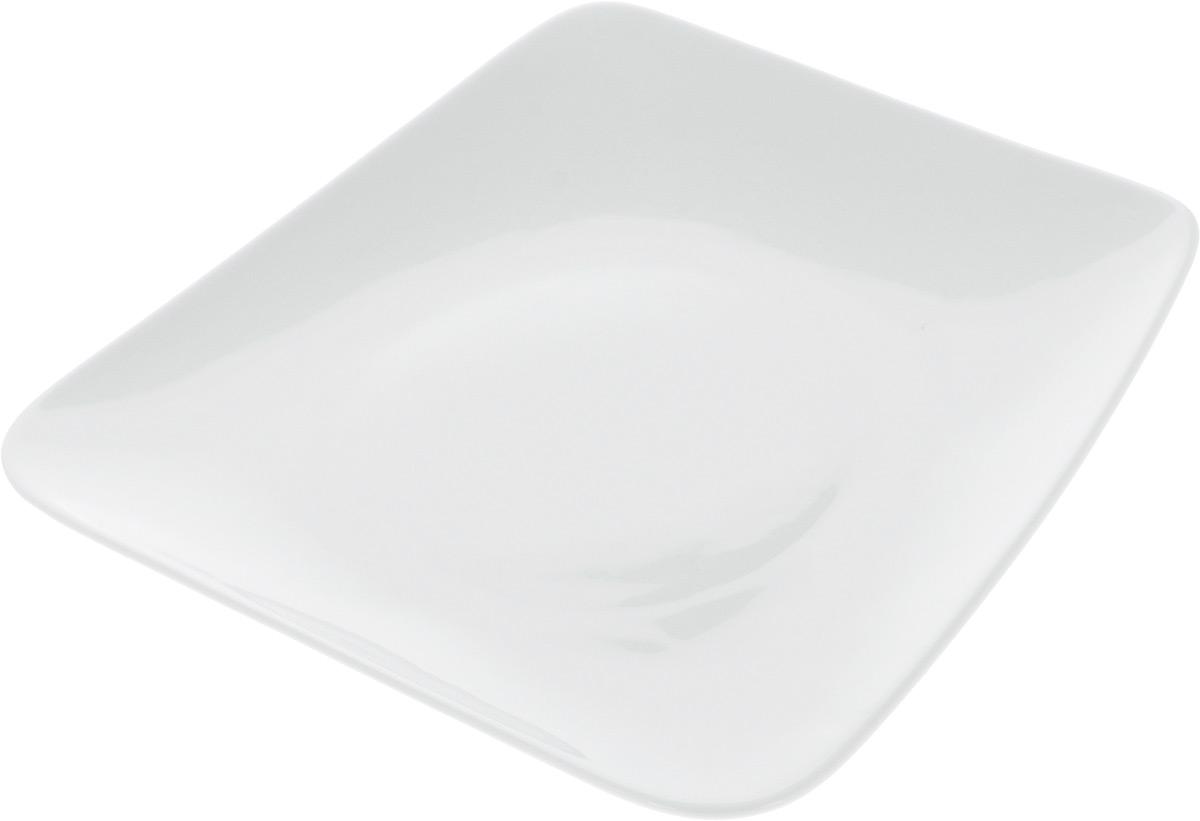 """Оригинальная тарелка Ariane """"Rectangle"""" изготовлена из высококачественного фарфора с глазурованным покрытием и имеет приподнятый край. Изделие идеально подходит для сервировки закусок и других блюд. Такая тарелка прекрасно впишется в интерьер вашей кухни и станет достойным дополнением к кухонному инвентарю. Можно мыть в посудомоечной машине и использовать в микроволновой печи. Размер тарелки (по верхнему краю): 27,5 х 26 см. Максимальная высота тарелки: 3 см."""