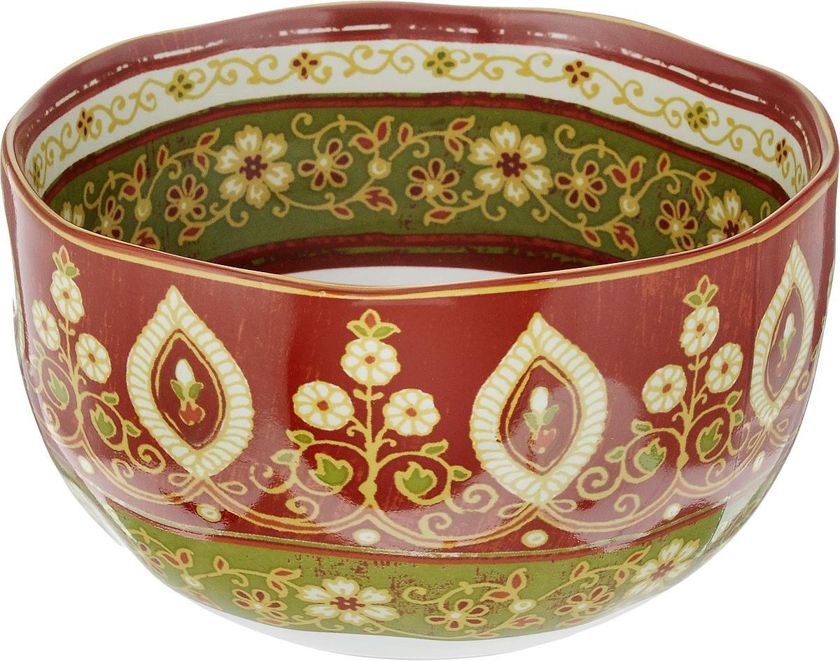 Салатник Sango Ceramics Кашмир, диаметр 15 смUTT41640Салатник Sango Ceramics Кашмир выполнен из высококачественной керамики с покрытием пищевой глазурью. Изделие отлично подходит для сервировки салатов, закусок, овощей и фруктов. Хорошо подходит для разогревания еды в СВЧ, так как долго сохраняет тепло. Такой салатник отлично подойдет для повседневного использования. Он прекрасно впишется в интерьер вашей кухни. Посуда термостойкая, можно использовать в духовке и в микроволновой печи. Диаметр (по верхнему краю): 15 см. Высота стенки: 8 см.