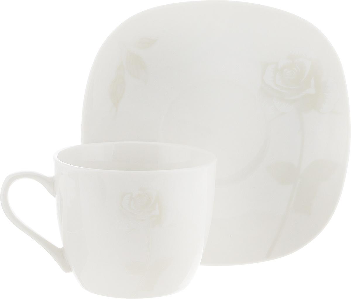 Чайная пара Жемчужная роза, цвет: молочный, 2 предмета216694Чайная пара Жемчужная роза состоит из чашки и блюдца, изготовленных из высококачественной керамики. Красочность оформления придется по вкусу ценителям утонченности и изысканности. Диаметр чашки по верхнему краю:8 см. Высота чашки: 7 см. Объем чашки: 220 мл. Размер блюдца: 15 см х 15 см.