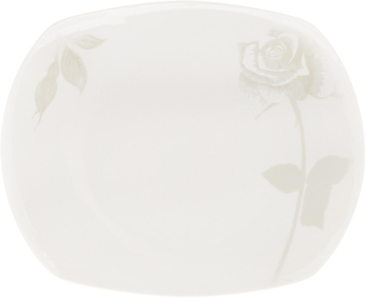 Блюдо Жемчужная роза, 22,5 x 18,5 см216698Оригинальное блюдо Жемчужная роза, изготовленное из фарфора с глазурованным покрытием, прекрасно подойдет для подачи нарезок, закусок и других блюд. Оно украсит ваш кухонный стол, а также станет замечательным подарком к любому празднику.Размер блюда: 22,5 x 18,5 см.