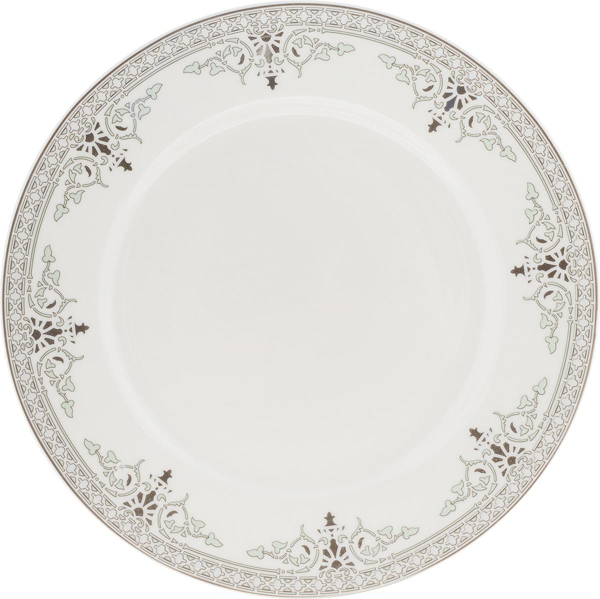 Тарелка десертная Венеция, диаметр 19 см216685Десертная тарелка Венеция изготовлена из глазурованного фарфора. Она предназначена для подачи десертов. Также может использоваться как блюдо для сервировки закусок.Изящная тарелка прекрасно оформит стол и порадует ваших гостей изысканным дизайном и формой. Диаметр тарелки: 19 см.
