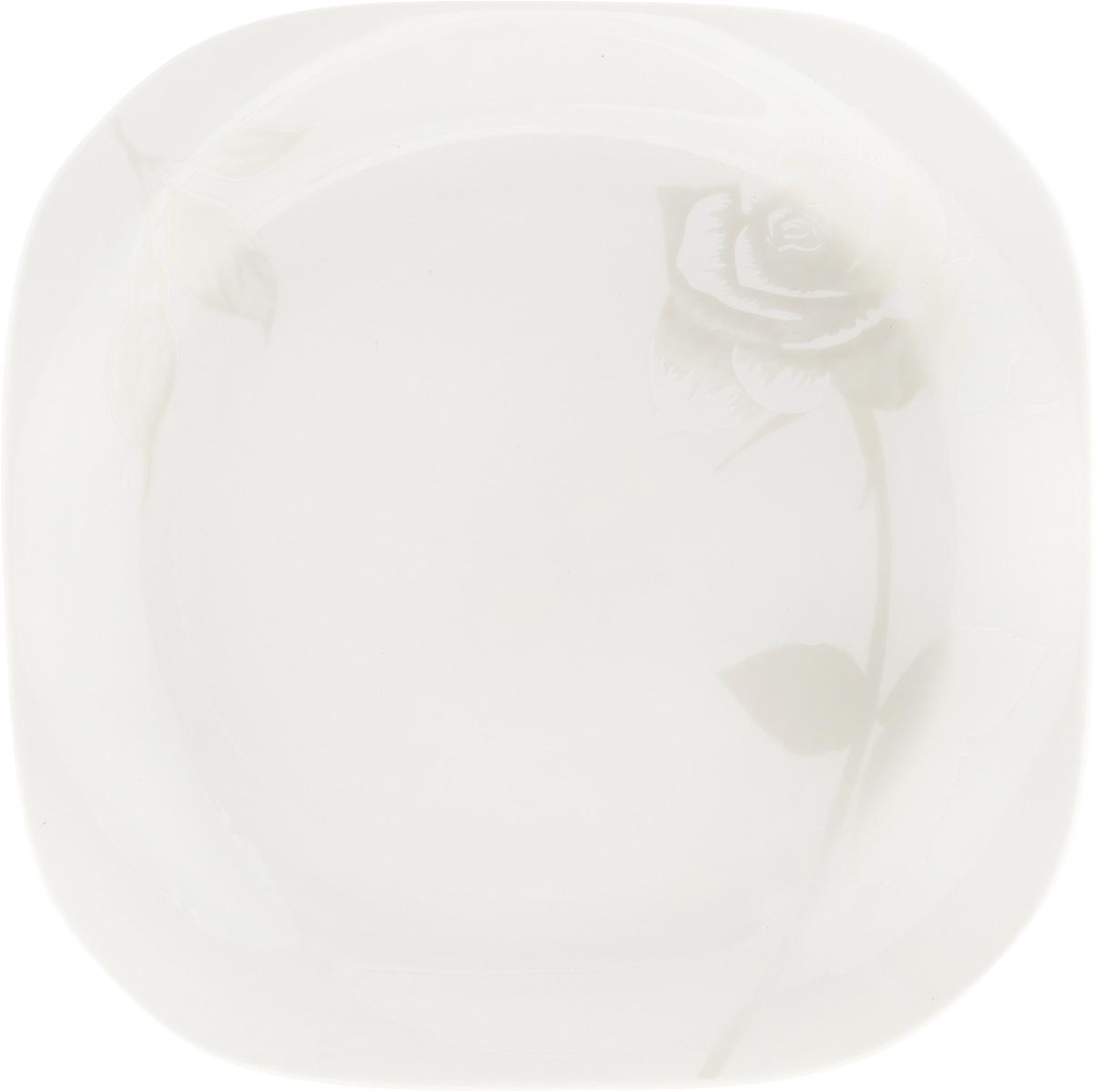 Тарелка десертная Жемчужная роза, 18 x 18 см216693Десертная тарелка Жемчужная роза изготовлена из глазурованного фарфора. Она предназначена для подачи десертов. Также может использоваться как блюдо для сервировки закусок.Изящная тарелка прекрасно оформит стол и порадует ваших гостей изысканным дизайном и формой. Размер тарелки: 18 х 18 см.