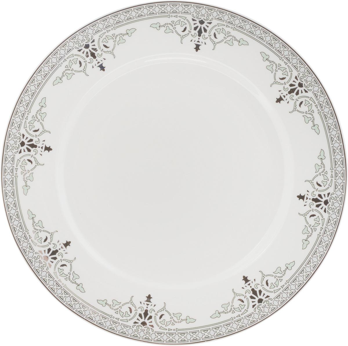 Тарелка подстановочная Венеция, диаметр 27 см216687Тарелка Венеция изготовлена из глазурованного фарфора. Подстановочная тарелка - это особый вид тарелок. Обычно она выполняет исключительно декоративную функцию.Такая тарелка изысканно украсит сервировку как обеденного, так и праздничного стола. Диаметр тарелки: 27 см.