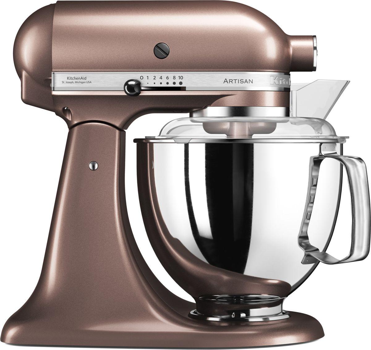 KitchenAid Artisan, Light Brown миксер планетарный (5KSM175PSEAP)5KSM175PSEAPМиксер KitchenAid Artisan - это уникальное многофункциональное устройство, практически не имеющее аналогов на рынке техники для дома и кухни. Сочетание классического элегантного дизайна и высокой мощности, соответствующей стандартам профессионального оборудования, делает этот миксер фаворитом не только на домашней кухне, но и на рабочем столе мастеров поварского искусства.Откидывающаяся головка миксера KitchenAid Artisan позволяет легко менять насадки и устанавливать чашу. Миксер имеет 10 скоростных режимов, от медленного смешивания до высокоскоростного взбивания. Базовая комплектация миксера включает: чашу объемом 4,83 литра, крюк для теста, венчик для взбивания, насадку-лопатку для перемешивания, крышку для чаши и защитный обод с воронкой для засыпания продуктов. Этого набора достаточно, чтобы миксер успешно выполнял базовые функции.В передней части привода миксера KitchenAid имеется еще одно гнездо для подсоединения дополнительных насадок. Они позволяют значительно расширить функции миксера, превращая его в настоящий кухонный комбайн. Планетарный миксер KitchenAid Artisan избавит вас от необходимости покупать несколько разных бытовых приборов для кухни. Его высокая мощность и уникальная конструкция позволяют готовить даже сложные блюда на высоком профессиональном уровне.Процесс производства миксеров KitchenAid не оставляет сомнений в долговечности этого прибора. Литые детали механизма изготовлены из высококачественной стали. Ручная сборка и тщательная подгонка частей привода обеспечивают низкий уровень шума и вибрации, являются гарантией безупречной работы прибора. Цельнометаллический корпус покрывается прочной цветной эмалью, устойчивой к механическим повреждениям, которая сохраняет привлекательный внешний десятилетиями. Классический дизайн миксеров KitchenAid Artisan станет украшением интерьера любой кухни. Одна из отличительных особенностей этой серии – богатая цветовая гамма.