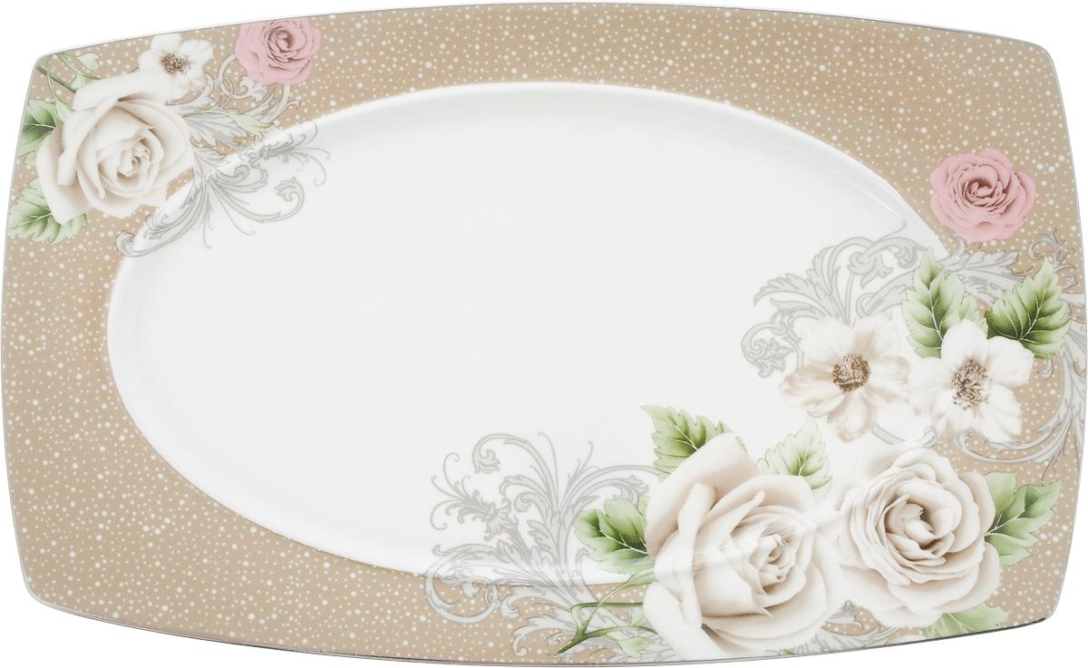Блюдо для нарезки Florance, 25 х 16 смPR7998Блюдо для нарезки Florance, изготовленное из фарфора, оформлено цветочным принтом. Такое блюдо сочетает в себе изысканный дизайн с максимальной функциональностью. Красочность оформления придется по вкусу тем, кто предпочитает утонченность и изящность. Оригинальное блюдо украсит сервировку вашего стола и подчеркнет прекрасный вкус хозяйки, а также станет отличным подарком.