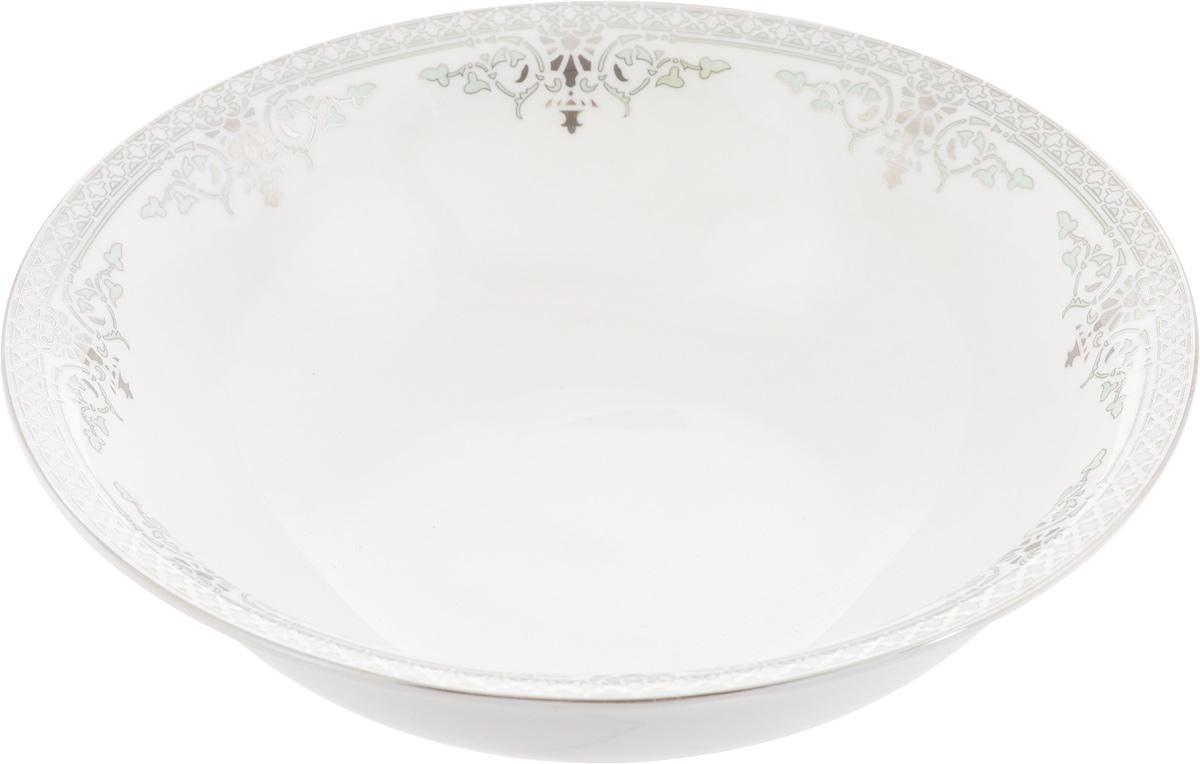 Салатник Венеция, диаметр 23 см216689Элегантный салатник Венеция, изготовленный из высококачественного фарфора с глазурованным покрытием, прекрасно подойдет для подачи различных блюд: закусок, салатов или фруктов. Такой салатник украсит ваш праздничный илиобеденный стол, а оригинальное исполнение понравится любой хозяйке. Диаметр салатника (по верхнему краю): 23 см. Высота салатника: 7 см.