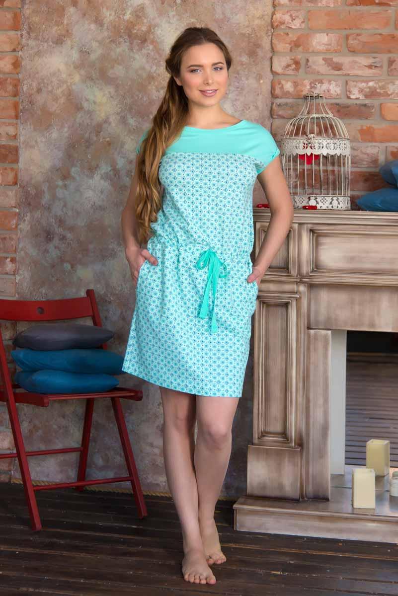 Платье женское Mia Cara Portugal, цвет: бирюзовый. AW16-MC-819. Размер 46/48AW16-MC-819Платье от Mia Cara с короткими рукавами, выполнено из трикотажа с добавлением эластана и дополнено стильным принтом. Модель с вырезом - лодочкой для горловины. По бокам расположены два внутренних кармана. Изделие оснащено затягивающимся шнурком.