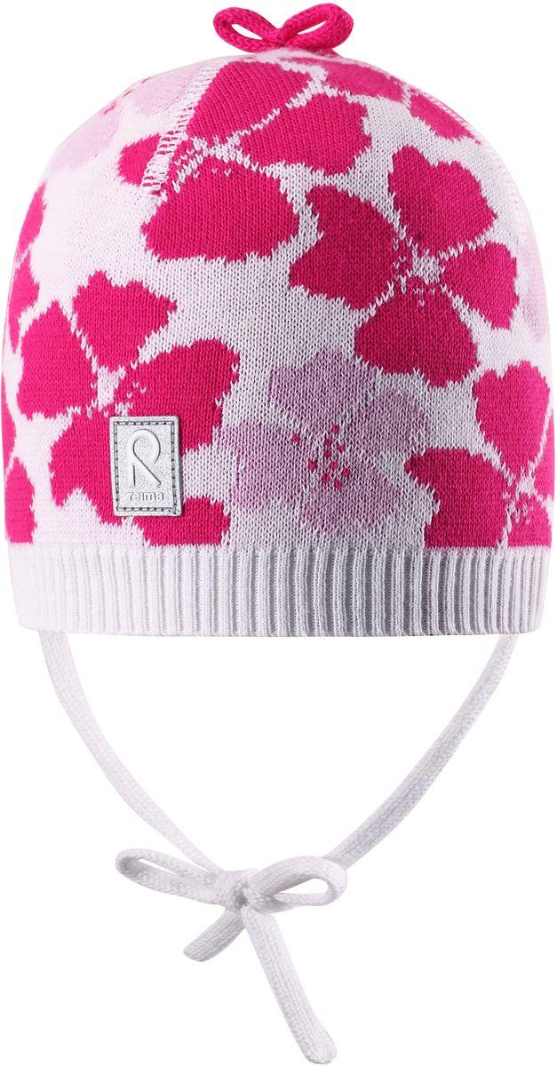 Шапка для девочки Reima Brisky, цвет: белый. 5184040100. Размер 525184040100Детская шапка яркой расцветки рассчитана на межсезонье, в ней можно и поиграть во дворе, и прогуляться по городу. Она изготовлена из мягкого и комфортного вязаного хлопка. Эта облегченная модель без подкладки, идеально подходит для солнечной погоды.