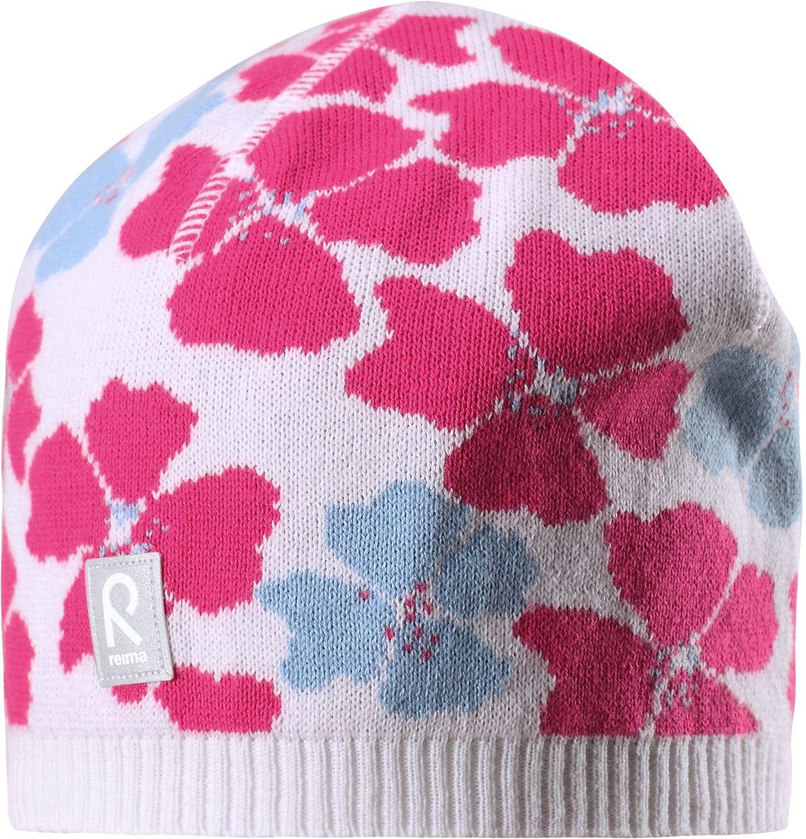 Шапка для девочки Reima Paradise, цвет: белый. 5285230100. Размер 505285230100Удобная детская шапка яркой расцветки рассчитана на межсезонье, в ней можно и поиграть во дворе, и прогуляться по городу. Она изготовлена из мягкого и комфортного вязаного хлопка. Эта облегченная модель без подкладки идеально подходит для солнечной погоды. Яркий сплошной жаккардовый узор будет отлично смотреться.