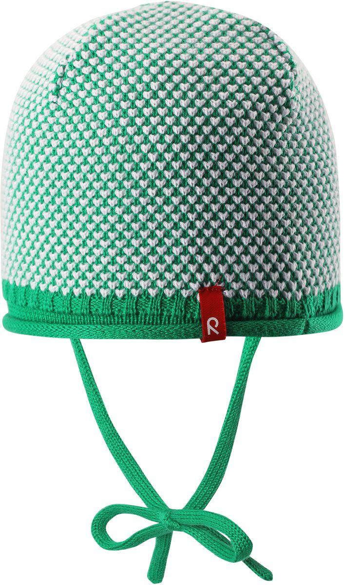 Шапка детская Reima Capitano, цвет: зеленый. 5184078800. Размер 485184078800Детская шапка яркой расцветки рассчитана на межсезонье, в ней можно и поиграть во дворе, и прогуляться по городу. Она изготовлена из мягкого и комфортного вязаного хлопка. Эта облегченная модель без подкладки идеально подходит для солнечной погоды.