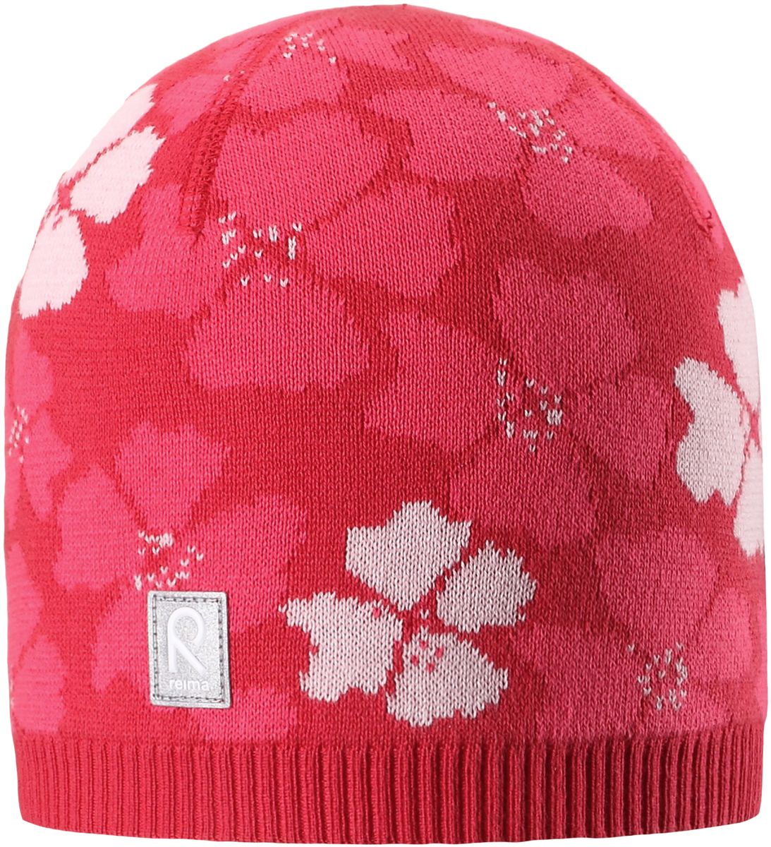 Шапка для девочки Reima Paradise, цвет: красный. 5285233720. Размер 565285233720Удобная детская шапка яркой расцветки рассчитана на межсезонье, в ней можно и поиграть во дворе, и прогуляться по городу. Она изготовлена из мягкого и комфортного вязаного хлопка. Эта облегченная модель без подкладки идеально подходит для солнечной погоды. Яркий сплошной жаккардовый узор будет отлично смотреться.
