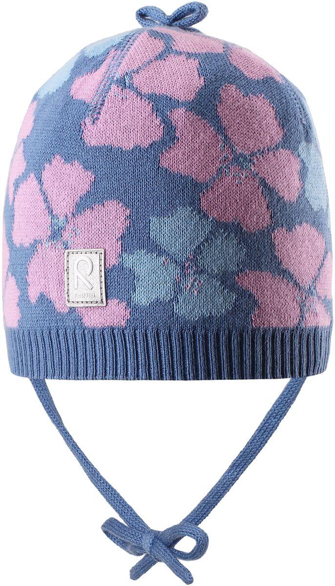 Шапка для девочки Reima Brisky, цвет: синий. 5184046550. Размер 485184046550Детская шапка яркой расцветки рассчитана на межсезонье, в ней можно и поиграть во дворе, и прогуляться по городу. Она изготовлена из мягкого и комфортного вязаного хлопка. Эта облегченная модель без подкладки, идеально подходит для солнечной погоды.