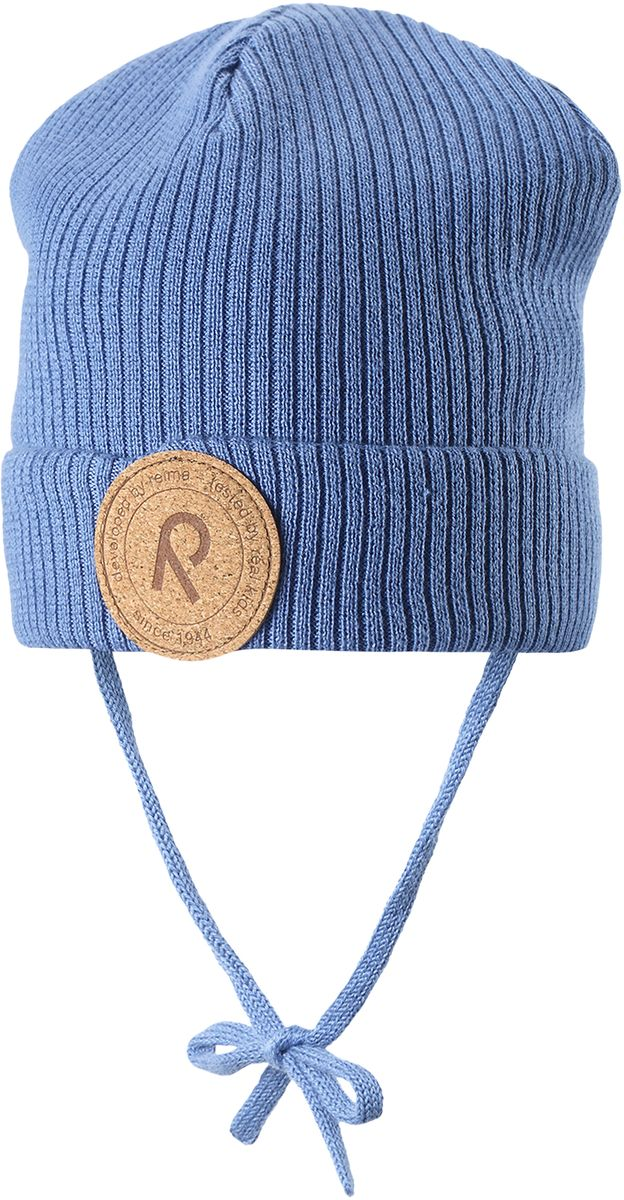 Шапка детская Reima Meri, цвет: синий. 5184126550. Размер 465184126550Детская шапка яркой расцветки рассчитана на межсезонье, в ней можно и поиграть во дворе, и прогуляться по городу. Она изготовлена из мягкого и комфортного вязаного хлопка. Снабжена теплой дышащей подкладкой и завязками.