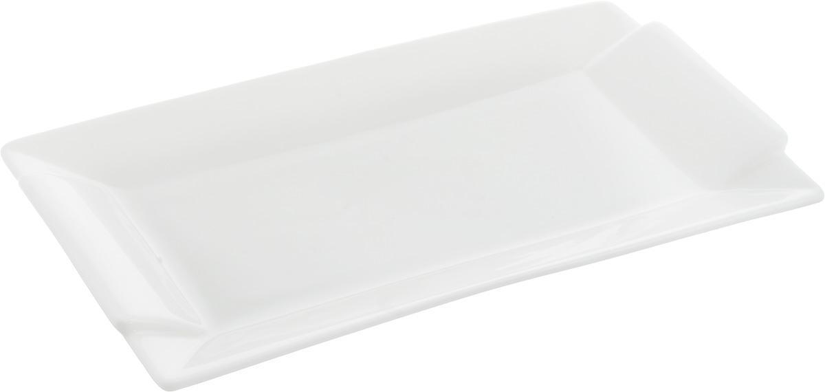 Блюдо Wilmax, прямоугольное, 24 х 12 смWL-992645 / AОригинальное блюдо Wilmax, изготовленное из фарфора с глазурованным покрытием, прекрасно подойдет для подачи нарезок, закусок и других блюд. Оно украсит ваш кухонный стол, а также станет замечательным подарком к любому празднику.Можно мыть в посудомоечной машине и использовать в микроволновой печи.Размер блюда (по верхнему краю): 24 х 12 см.Высота блюда: 2 см.