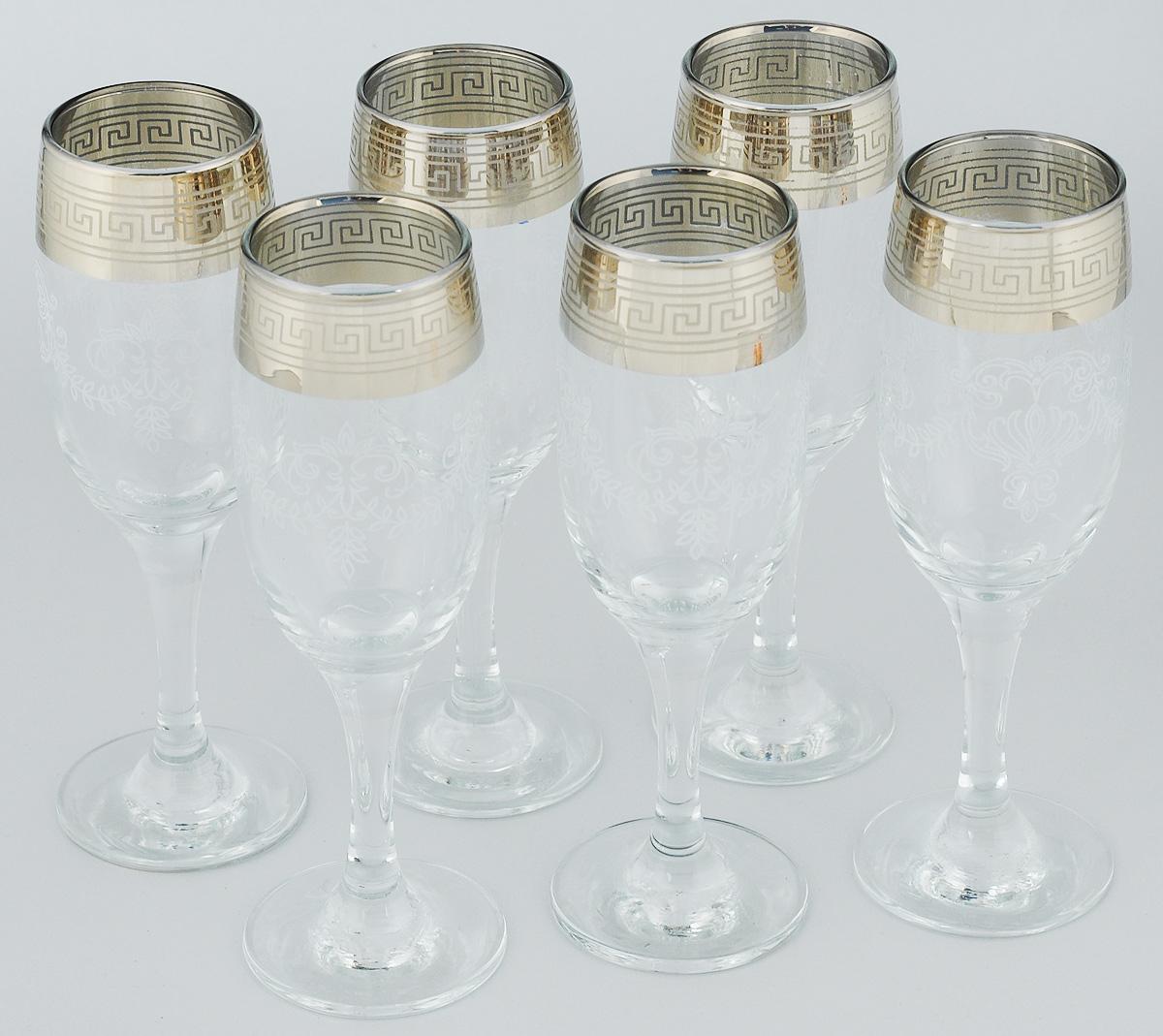 """Набор Гусь-Хрустальный """"Гармония"""" состоит из шести бокалов, выполненных из прочного натрий-кальций-силикатного стекла. Изящные бокалы на высоких  ножках, декорированные золотистым орнаментом и окантовкой, прекрасно подойдут для подачи шампанского. Они излучают приятный блеск и издают мелодичный звон. Бокалы сочетают в себе элегантный дизайн и функциональность. Благодаря такому набору пить напитки будет еще вкуснее. Набор бокалов Гусь-Хрустальный """"Гармония"""" прекрасно оформит праздничный стол и создаст приятную атмосферу за романтическим ужином. Такой набор также  станет хорошим подарком к любому случаю. Диаметр бокала (по верхнему краю): 5 см.Высота бокала: 19,5 см.Диаметр основания: 6,3 см."""