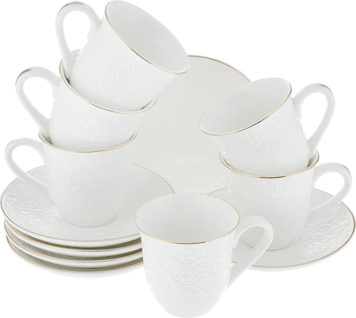 Набор кофейный Loraine, 12 предметов. 2576925769Кофейный набор Loraine состоит из 6 чашек и 6 блюдец. Изделия выполнены из высококачественного костяного фарфора и оформлены золотистой каймой. Такой набор станет прекрасным украшением стола и порадует гостей изысканным дизайном и утонченностью. Набор упакован в подарочную коробку, задрапированную внутри белой атласной тканью. Каждый предмет надежно зафиксирован внутри коробки. Кофейный набор Loraine идеально впишется в любой интерьер, а также станет идеальным подарком для ваших родных и близких. Объем чашки: 90 мл. Диаметр чашки (по верхнему краю): 6,2 см. Высота чашки: 6 см. Диаметр блюдца (по верхнему краю): 11,2 см. Высота блюдца: 2 см.