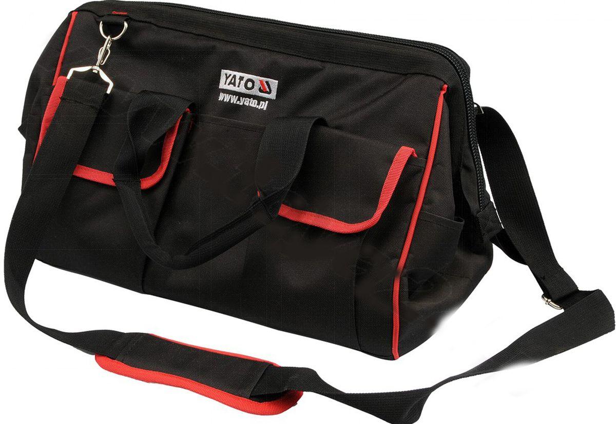 Сумка для инструментов Yato, цвет: черный, красный, 40 x 23 x 21смYT-7433Сумка Yato специально разработана для хранения и транспортировки инструмента. Она изготовлена из прочного нейлона и имеет практически неограниченный срок службы, а также превосходно защищает инструменты даже при работе в полевых условиях. Внутри сумки имеются карманы для хранения и быстрого доступа к инструменту. На боковых стенках имеются карманы для ключей, плоскогубцев и других инструментов. Сумка снабжена прочной лямкой на плечо и закрывается на молнию. Сумка для инструментов Yato позволяет поддерживать чистоту на рабочем месте.