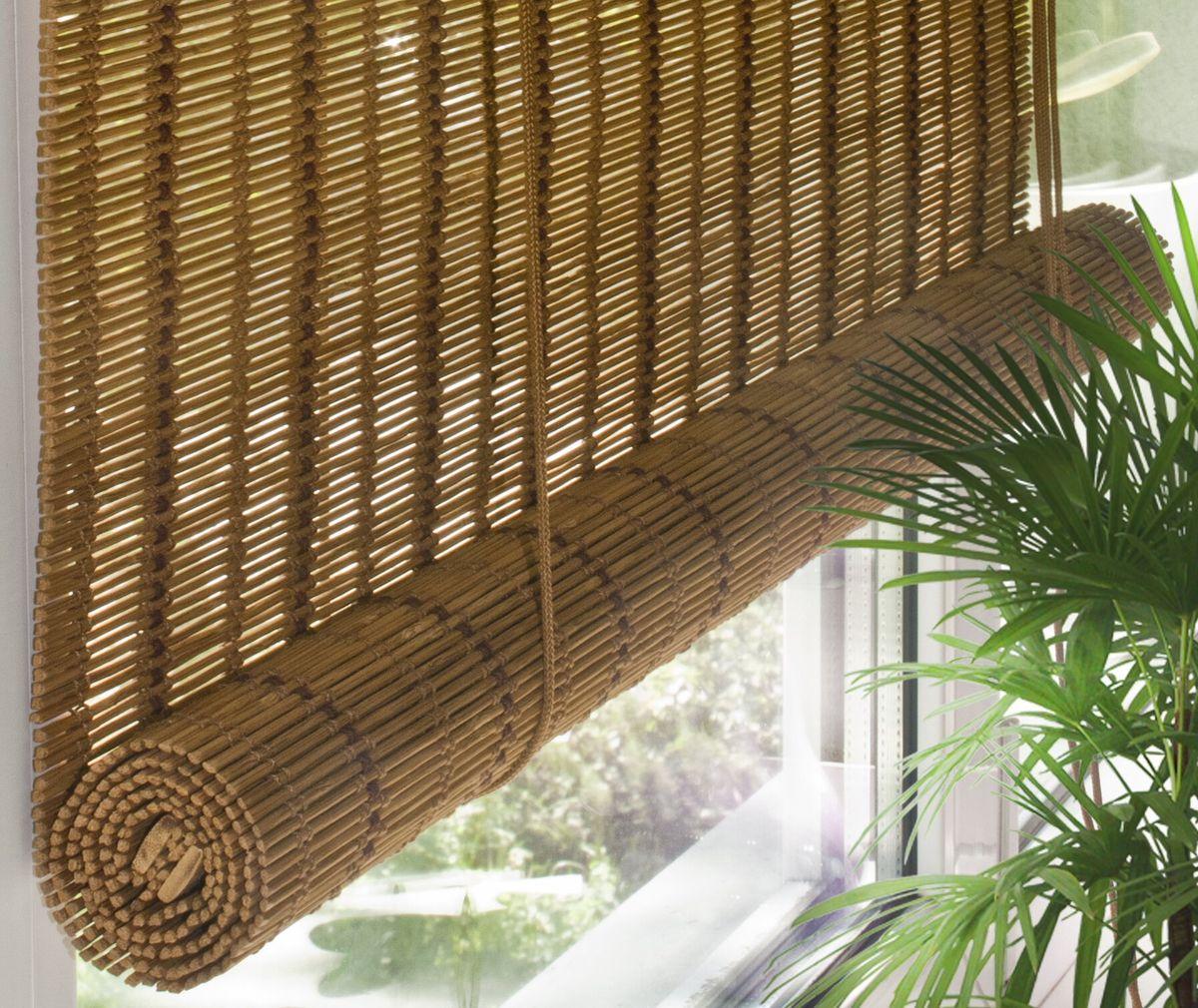 Штора рулонная Эскар Бамбук, цвет: медный, ширина 160 см, высота 160 см70142160160При оформлении интерьера современных помещений многие отдают предпочтение природным материалам. Бамбуковые рулонные шторы - одно из натуральных изделий, способное сделать атмосферу помещения более уютной и в то же время необычной. Свойства бамбука уникальны: он экологически чист, так как быстро вырастает, благодаря чему не успевает накопить вредные вещества из окружающей среды. Кроме того, растение обладает противомикробным и антибактериальным действием. Занавеси из бамбука безопасно использовать в помещениях, где находятся новорожденные дети и люди, склонные к аллергии. Они незаменимы для тех, кто заботится о своем здоровье и уделяет внимание высокому уровню жизни.Бамбуковые рулонные шторы представляют собой полотно, состоящее из тонких бамбуковых стеблей и сворачиваемое в рулон.Римские бамбуковые шторы, как и тканевые римские шторы, при поднятии образуют крупные складки, которые прекрасно декорируют окно.Особенность устройства полотна позволяет свободно пропускать дневной свет, что обеспечивает мягкое освещение комнаты. Это натуральный влагостойкий материал, который легко вписывается в любой интерьер, хорошо сочетается с различной мебелью и элементами отделки. Использование бамбукового полотна придает помещению необычный вид и визуально расширяет пространство.Помимо внешней красоты, это еще и очень удобные конструкции, экономящие пространство. Изготавливаются они из специальных материалов, устойчивых к внешним воздействиям. Сама штора очень эргономичная, и позволяет изменять визуально пространство в зависимости от потребностей владельца.