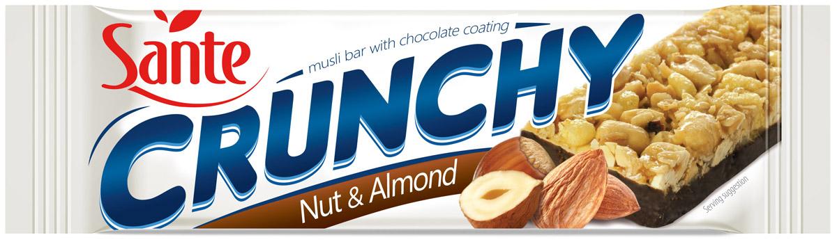 Sante Crunchy батончикмюслисорехамииминдалем в шоколаде,40г5900617015716Хрустящие батончики имеют отличный вкус и питательные свойства. Батончики мюсли Crunchy со орехами и миндалем в шоколаде изготавливаются из натуральных ингредиентов (таких как овсяные и кукурузные хлопья, арахис и миндаль). Эти батончики - отличная альтернатива калорийным шоколадным батончикам. Батончики Crunchy – это хороший перекус на работе или во время прогулки. Идеальная энергетическая поддержка между основными приемами пищи.Уважаемые клиенты! Обращаем ваше внимание, что полный перечень состава продукта представлен на дополнительном изображении.