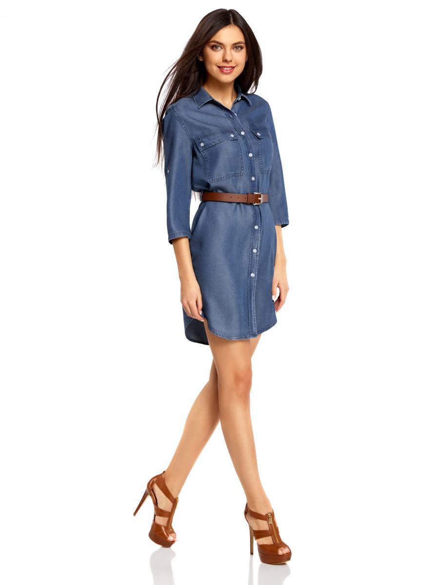Платье-рубашка oodji Ultra, цвет: синий. 12909052/45490/7500W. Размер 38-170 (44-170)12909052/45490/7500WДжинсовое платье-рубашка oodji Ultra - стильное и модное решение на каждый день. Модель мини-длины с рукавами 3/4 и отложным воротничком спереди застегивается на пуговицы по всей длине. На груди изделие дополнено двумя накладными карманами с клапанами на пуговицах. Рукава можно подвернуть и зафиксировать при помощи хлястиков с пуговицами.В комплект с платьемвходит ремень из искусственной кожи с металлической пряжкой.