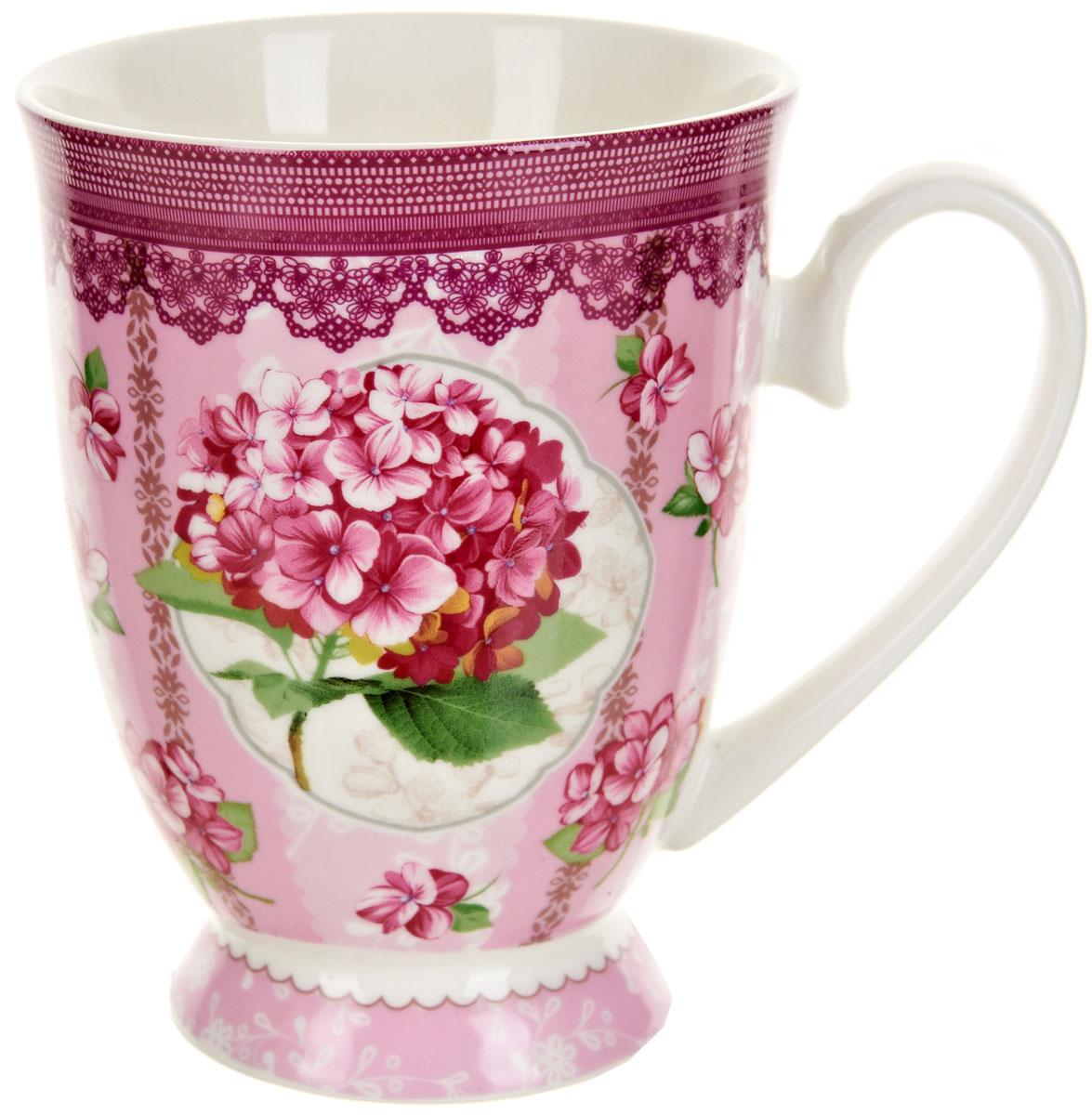 Кружка Polystar Розовая гортензия, 360 млL0990555Оригинальная кружка Polystar, выполненная из фарфора, сочетает в себе изысканный дизайн с максимальной функциональностью.Красочность оформления кружки придется по вкусу и ценителям классики, и тем, кто предпочитает утонченность и изысканность. Можно использовать в микроволной печи и мыть в посудомоечной машине.Объем: 360 мл.