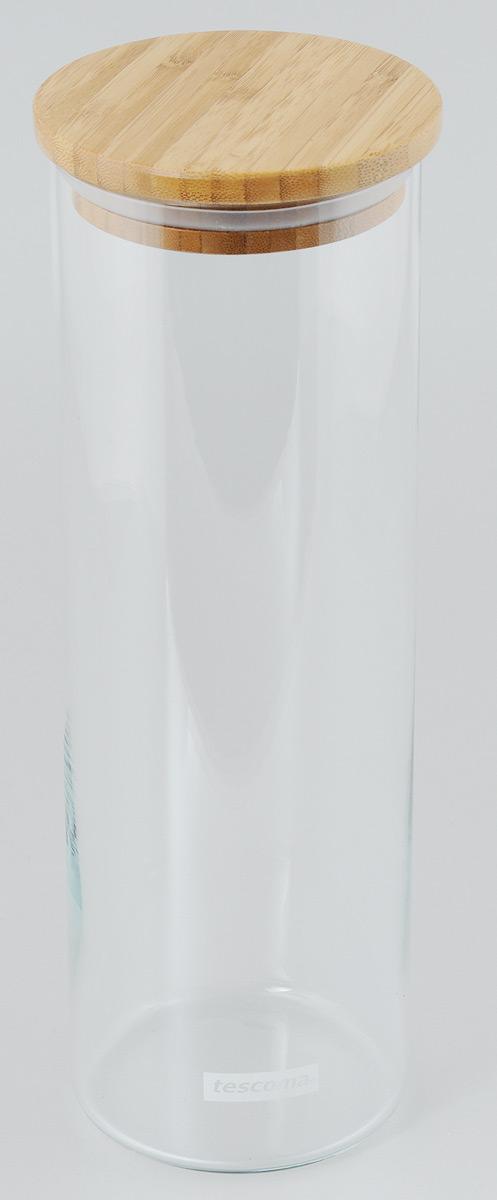 Банка для сыпучих продуктов Tescoma Fiesta, цвет: прозрачный, дерево, 1,8л894626Банка для сыпучих продуктов Tescoma Fiesta, изготовленная из прочного боросиликатного стекла, позволит вам хранить разнообразные сыпучие продукты, такие как кофе, крупы, сахар, соль или специи. Емкость оснащена плотно прилегающей крышкой, изготовленной из дерева и снабженная силиконовой прокладкой. Банка для сыпучих продуктов станет незаменимым помощником на кухне.Можно мыть в посудомоечной машине, крышку - нельзя. Диаметр по верхнему краю: 9 см.Диаметр дна: 9 см.Высота без учета крышки: 29 см.Высота с учетом крышки: 30 см.Объем: 1,8 л.
