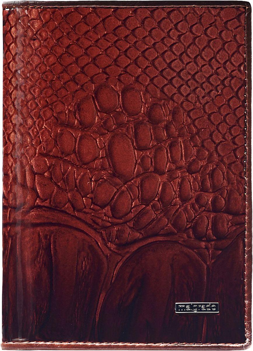 Обложка для паспорта женская Malgrado, цвет: коричневый. 54019-0440354019-04403 BrownСтильная обложка для паспорта Malgrado выполнена из натуральной лакированной кожи с тиснением под рептилию и оформлена металлической фурнитурой с символикой бренда.Изделие раскладывается пополам. Внутри расположены два накладных кармана, один из которых дополнен прозрачной вставкой из пластика, и пять накладных кармашков для пластиковых карт или визиток. Изделие дополнено съемным блоком для хранения автодокументов. Блок включает в себя четыре стандартных файла, один файл для хранения водительского удостоверения и один файл формата А3. Обложка для паспорта поставляется в фирменной упаковке.Обложка для паспорта поможет сохранить внешний вид ваших документов и защитит их от повреждений, а также станет стильным аксессуаром, который подчеркнет ваш образ.