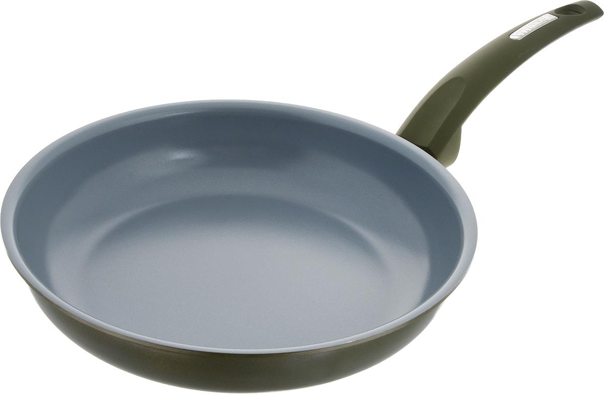 Сковорода Vitesse Le Grande, с керамическим покрытием, цвет: хаки. Диаметр 26 см. VS-2242VS-2242_зеленыйСковорода Vitesse Le Grande изготовлена из высококачественного алюминия с внутренним керамическим покрытием премиум-класса Eco-Cera. Благодаря керамическому покрытию пища не пригорает и не прилипает к поверхности сковороды, что позволяет готовить с минимальным количеством масла. Кроме того, оно абсолютно безопасно для здоровья человека, так как не содержит вредной примеси PFOA. Изделие стойко к высоким температурам (до 450°С), устойчиво к царапинам.Сковорода быстро разогревается, распределяя тепло по всей поверхности, что позволяет готовить в энергосберегающем режиме, значительно сокращая время, проведенное у плиты.Изделие оснащено прочной ненагревающейся ручкой из бакелита с покрытием Soft-Touch. Пригодна для использования на всех типах плит, кроме индукционных. Внутренний диаметр сковороды: 26 см.Высота стенки сковороды: 5,5 см. Длина ручки: 18,5 см.