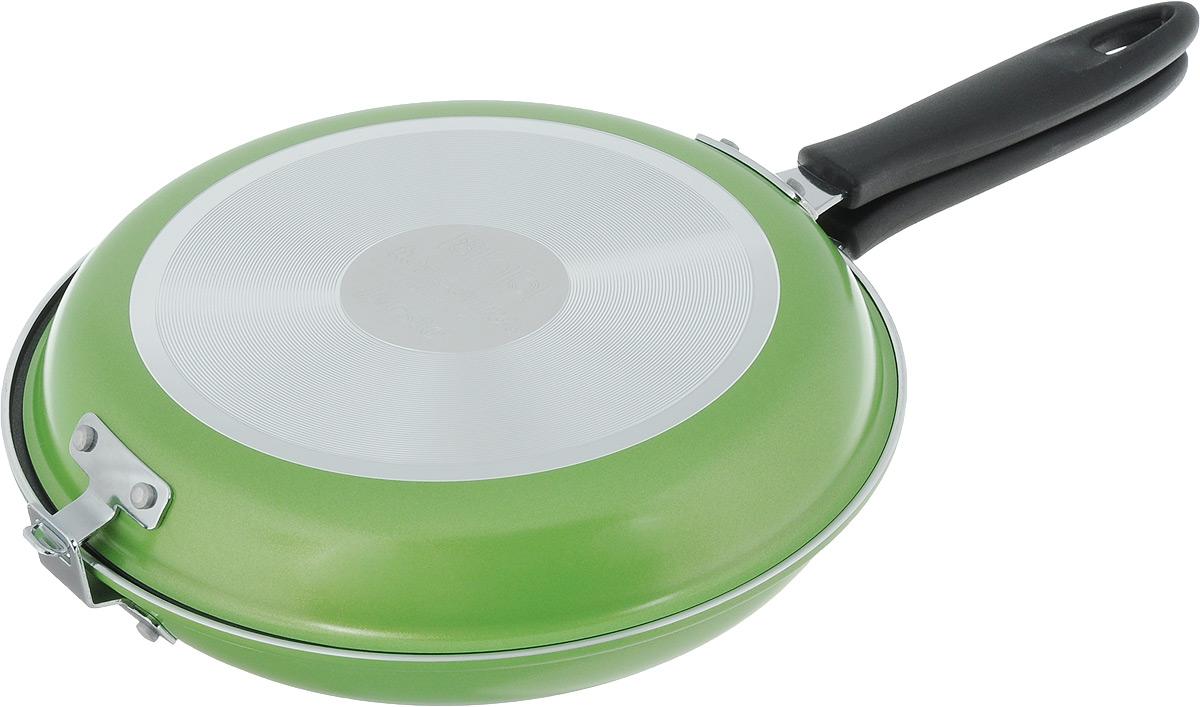 Сковорода двухсторонняя Tescoma Presto, цвет: зеленый, стальной. Диаметр 26см. 594346594346Высококачественная сковорода Tescoma Presto состоящая из двух частей, изготовлена из высококачественной нержавеющей стали с антипригарным покрытием. Сковорода идеальна для легкой и быстрой двухсторонней жарки и тушения продуктов. Прекрасно подходит для приготовления высоких омлетов типа тортилья, фриттата, фаршированных карманов, овощных и рисовых блюд и так далее. Снабжена ненагревающейся ручкой. Изделие можно использовать как две отдельные классические сковородки.В комплекте предоставлена брошюра с рецептами.Подходит для электрических, газовых и стеклокерамических плит. Можно мыть в посудомоечной машине.Диаметр нижней сковороды: 26 см. Диаметр верхней сковороды: 25 см.